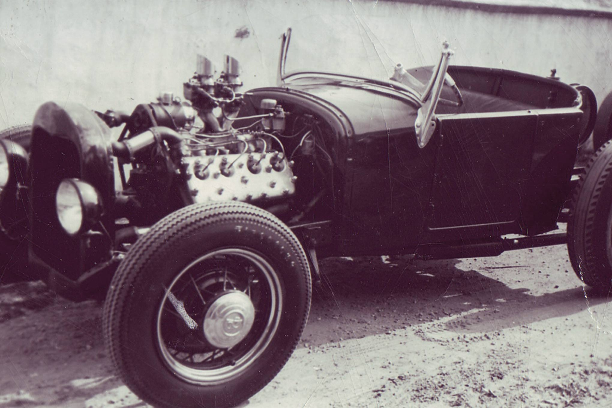 "This highboy roadster once belonged to dry lakes legend and speed shop owner Karl Orr. Dick was proud of the Edelbrock ""sling shot"" intake topped with Stromberg 97 carbs."