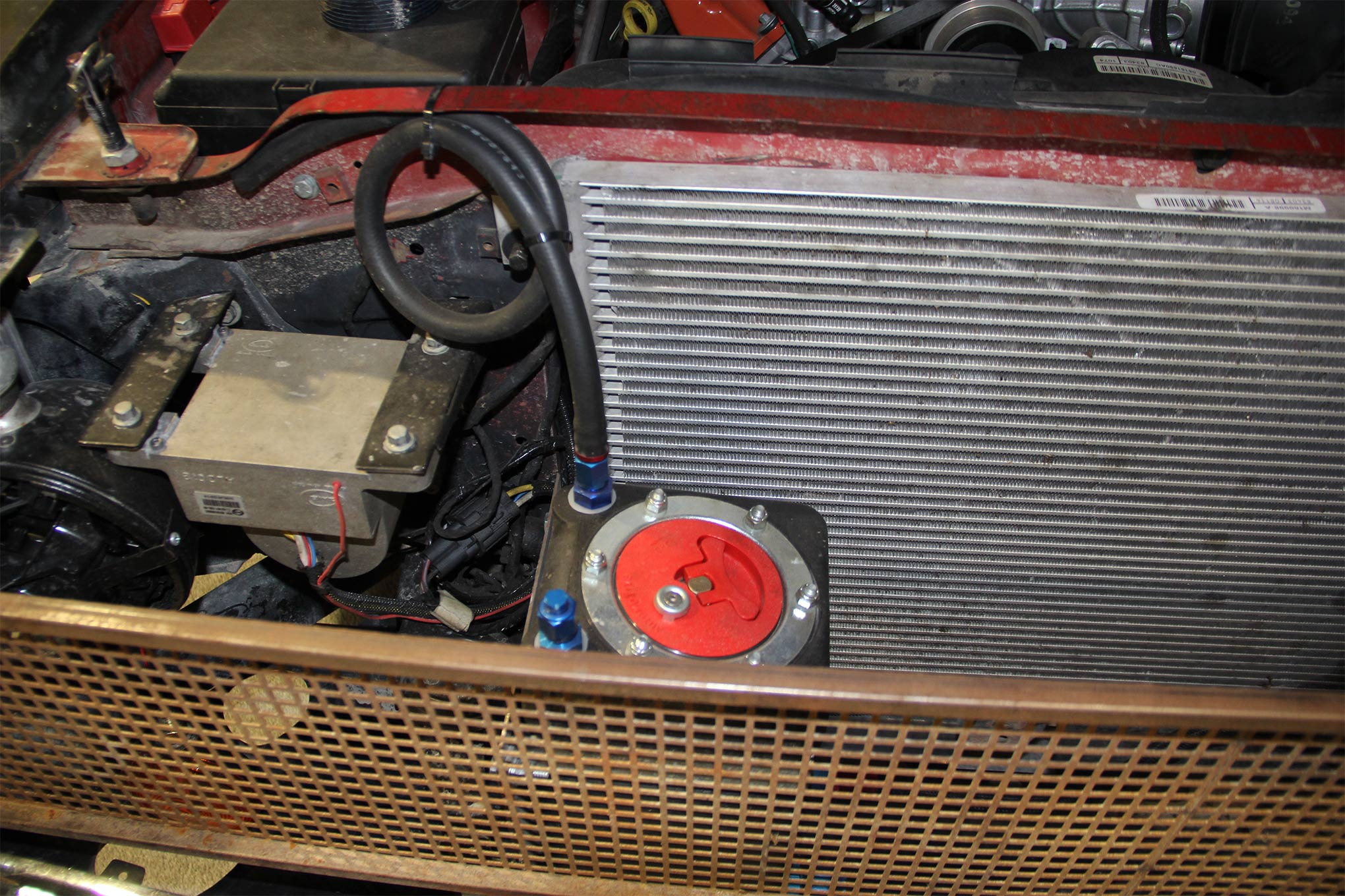 To trick the ECM into thinking it's controlling a stock Hellcat with its many features, Diversified even installed and wired in the ABS brake controller, though it doesn't control anything. Removing it from the overall system did not allow the engine to start.