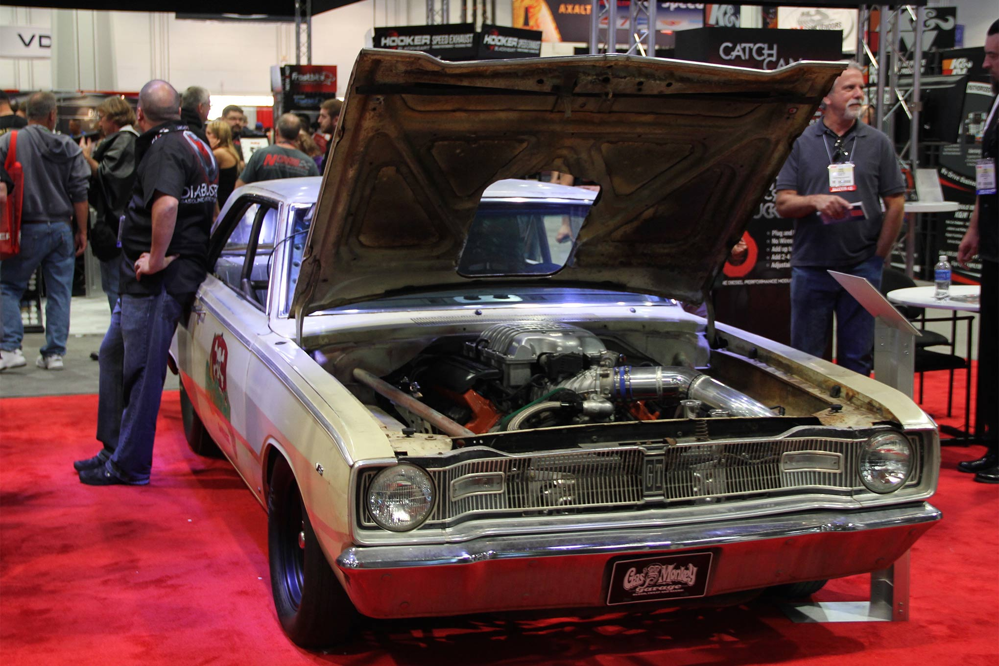 The Hellcat-powered Gas Monkey Garage 1967 Dodge Dart reposing at the 2015 SEMA Show in Las Vegas. The high placement of the engine necessitated relieving the hood for the air plenum. This was a moderately modified Dart with fabricated front-half and two-speed Powerglide transmission before Diablosport adapted the Hellcat engine and controllers that took three weeks to complete.
