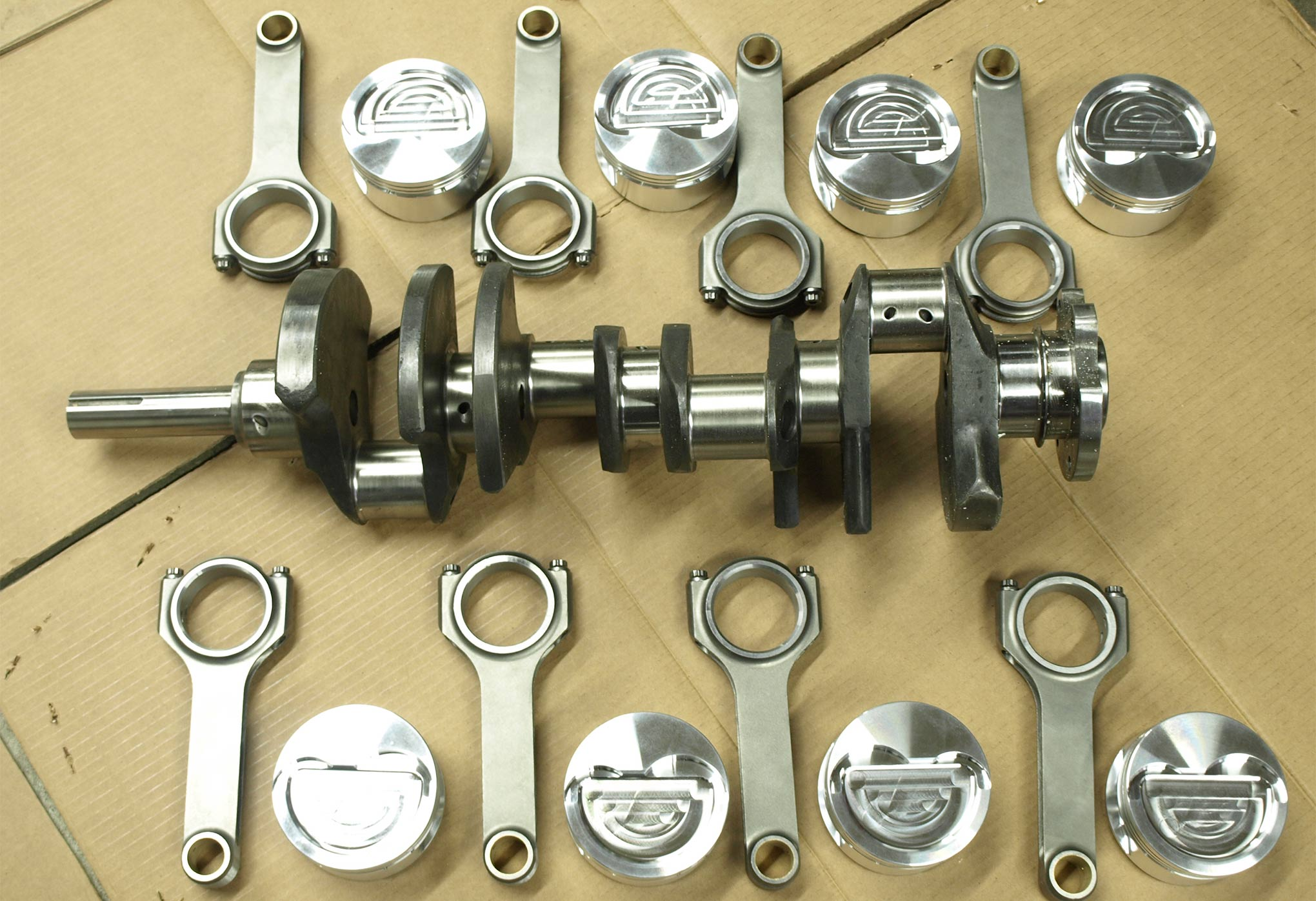 Working with the 0.050 cylinder overbore, the stock 3.78 stroke Ford crank gives way to a 4.250 inch 4340 forged steel replacement from Scat (PN 4FE200) that weighs 63.6 pounds and is internally balanced. Scat also offers a cast-iron version (PN 9FE200, 59.6 pounds) for penny-pinchers. Scat 6.700-inch rods and lightweight J&E forged pistons (521 grams each, PN 242931) complete the rotating assembly.