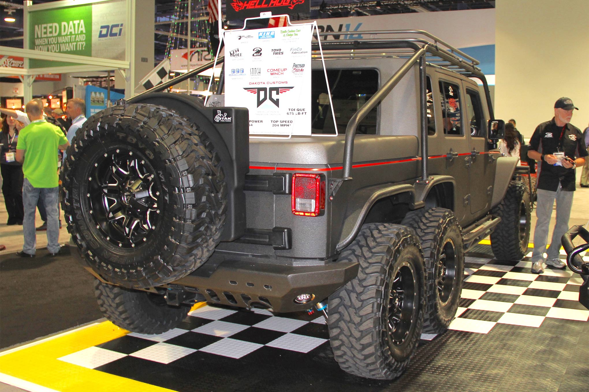 """Yes, Wild Boar's """"Hellhog"""" is a six-wheel Jeep Wrangler packing 800 hp of Hellcat goodness. Dakota Customs in Rapid City, South Dakota, provided the expertise to program the conversion. Utilizing the stock Jeep transmission necessitated finding a way to get the ECM's body control and transmission modules to communicate without those Hellcat components and functions."""