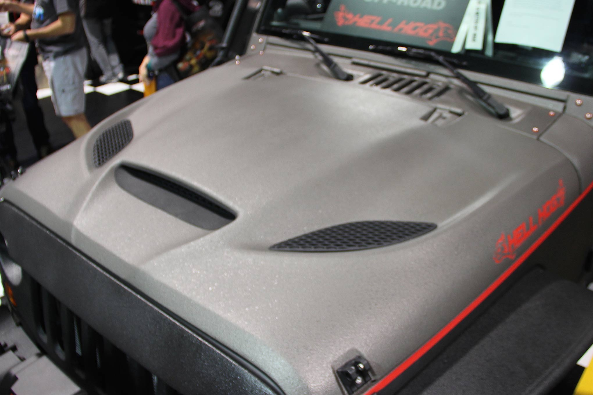 To make for a more compelling presentation and to telegraph the Hellcat connection, Wild Boar incorporated the Hellcat hoodscoop arrangement to the stock Wrangler hood with surprisingly successful results.