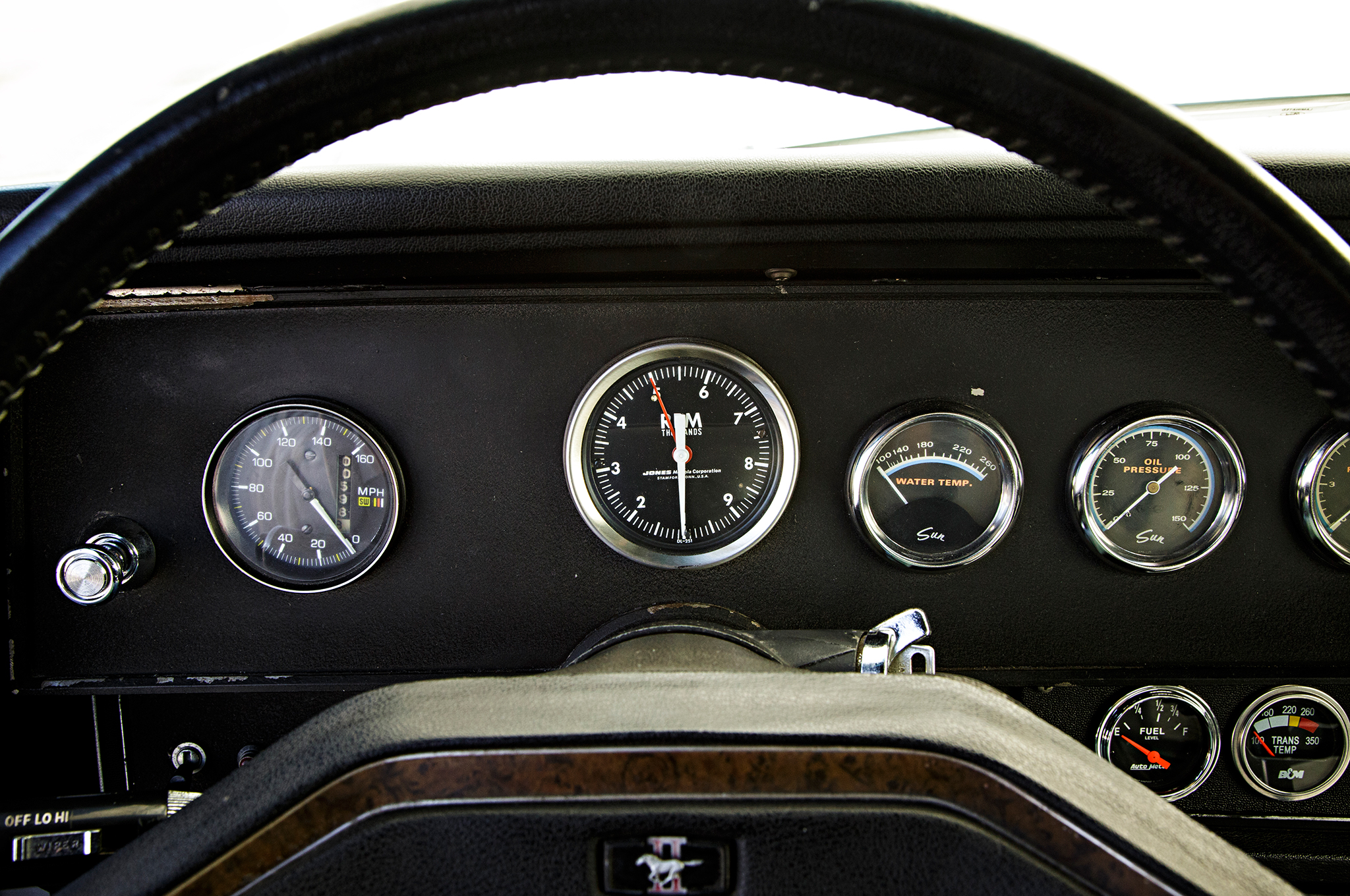 The gauge panel was custom fabricated by G&R and, it appears, was installed when the turbos were done. The steering wheel still shows some cigar burns from Joe Ruggirello.