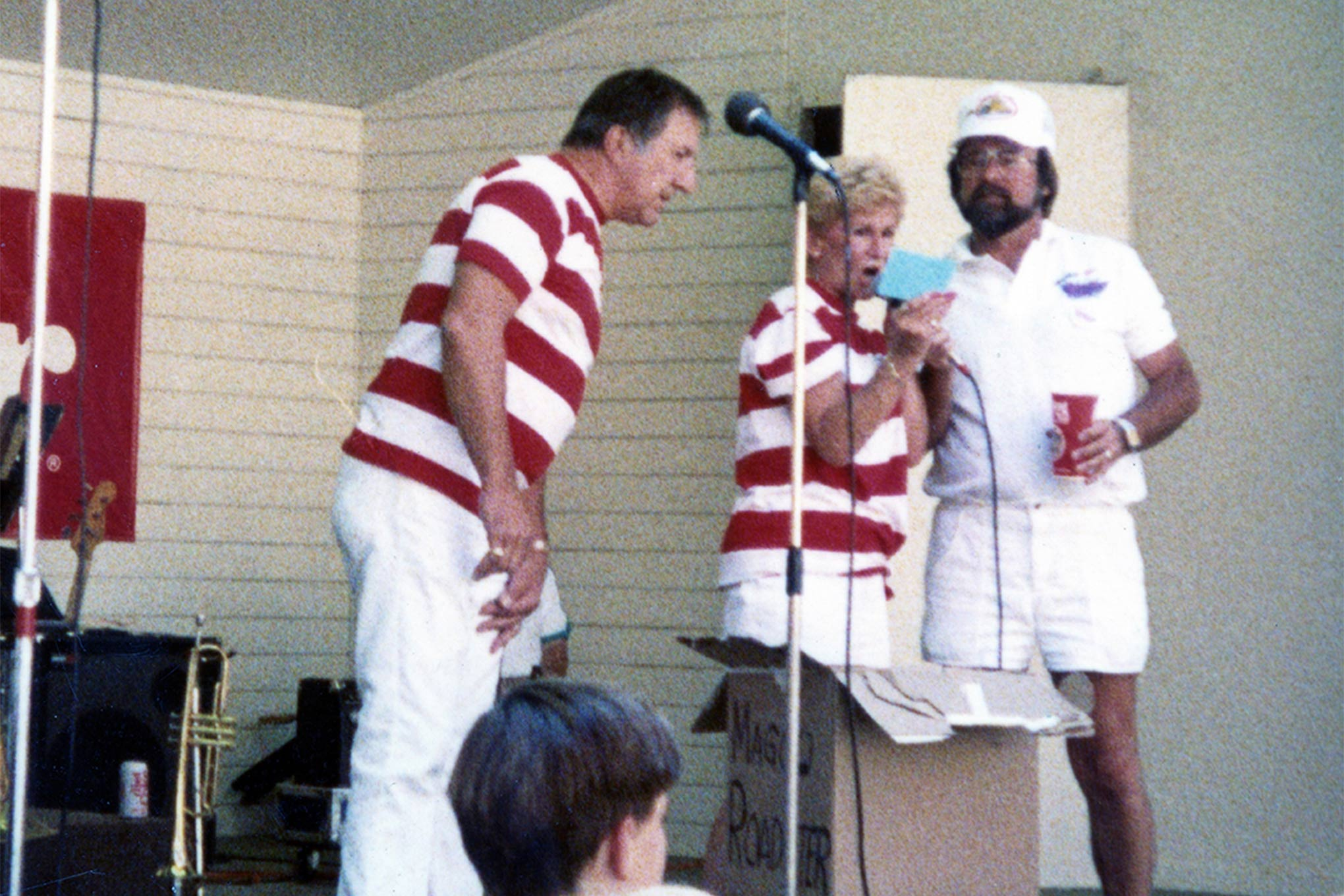 "Magoo and Lois on stage with the ""good guy"" himself Gary Meadors in 1987 at Pleasanton giving away one of the Magoo-built hot rods for the Goodguys Rod & Custom Association."