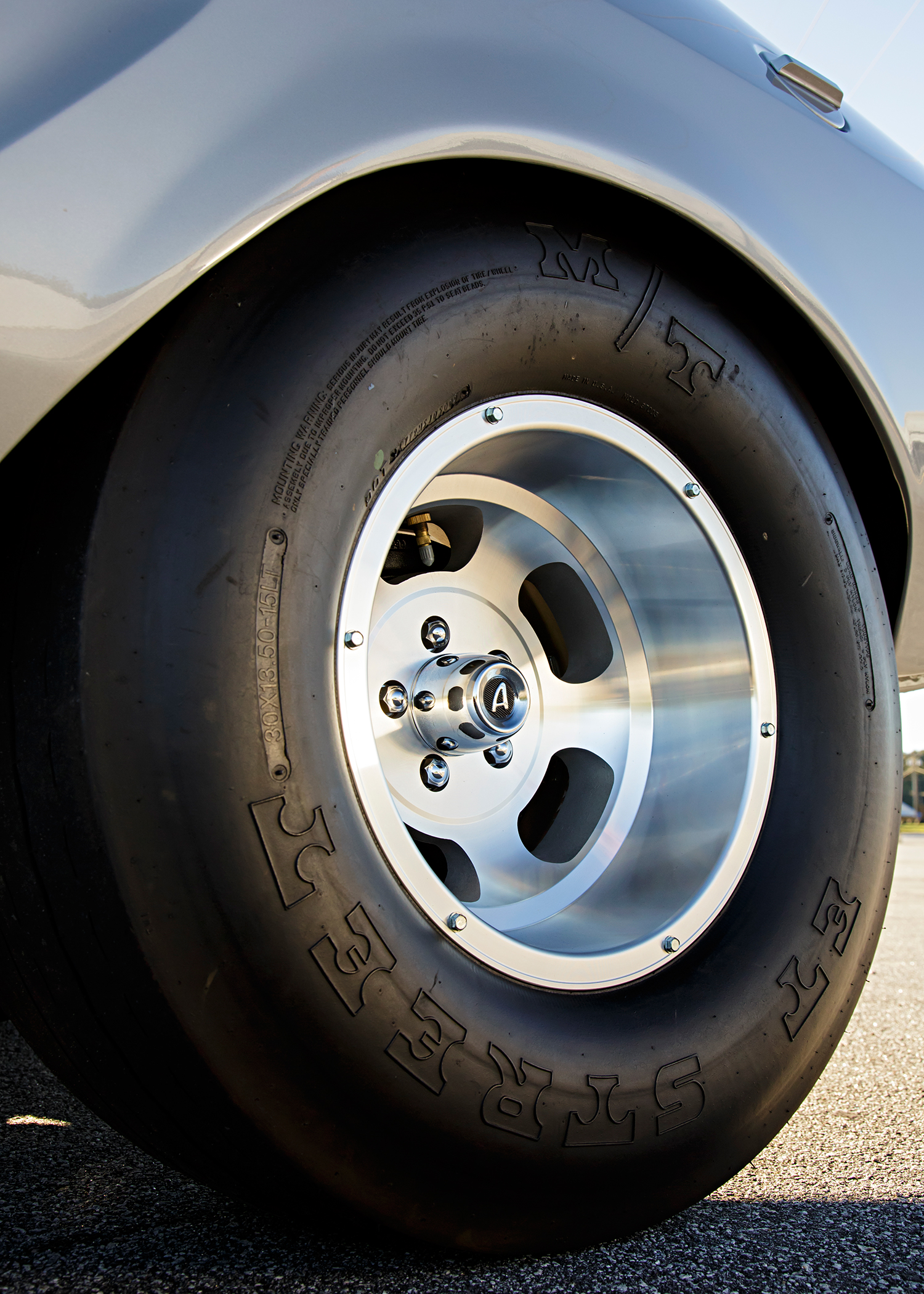 The rear slicks were originally Firestone Drag 500s in 29.5x15 size. They haven't been made for years, so the car now wears Mickey Thompson ET streets in a similar size. The wheels also had to be restored and were expertly brought back to their original machined finish. The front wheels were originally 13x6 ET slots with Goodyear D70-13 Polyglas tires. The tires are not reproduced, so Tate made the decision to install five-lug rotors and source a pair of 14x6 ET slots that would allow use of D70-14 Polyglas tires for the same look.