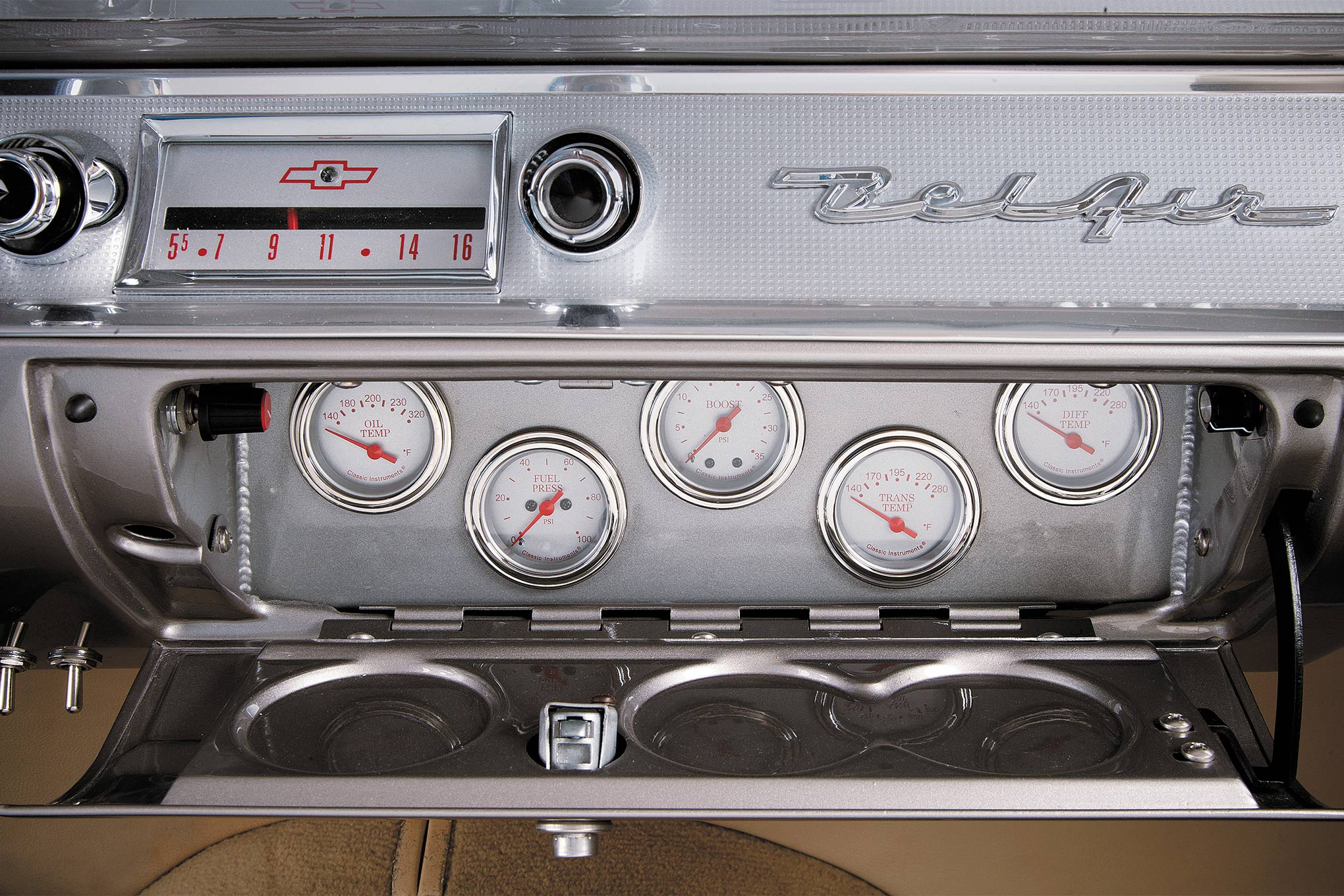 The stock dash is outfitted with Classic Instruments while the factory wheel was downsized to 14 inches and mounted on top of a Flaming River tilt column. The series input comes from these custom Classic Instrument gauges neatly packaged within the glovebox; oil temp, fuel pressure, boost, trans temp, and differential (yes, rearend) temp.