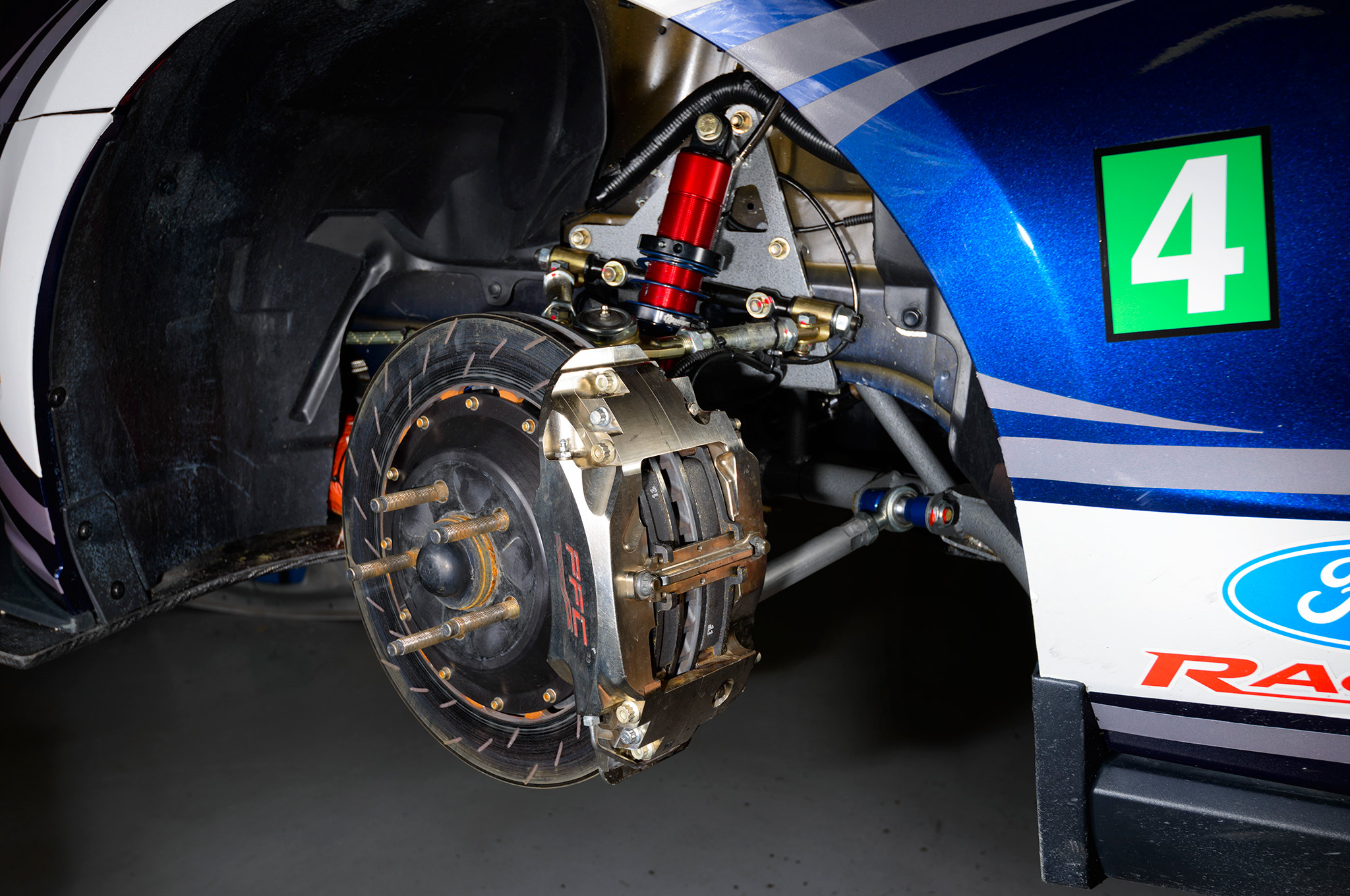 The front brake package includes 378mm rotors clamped by massive six-piston Performance Friction calipers.