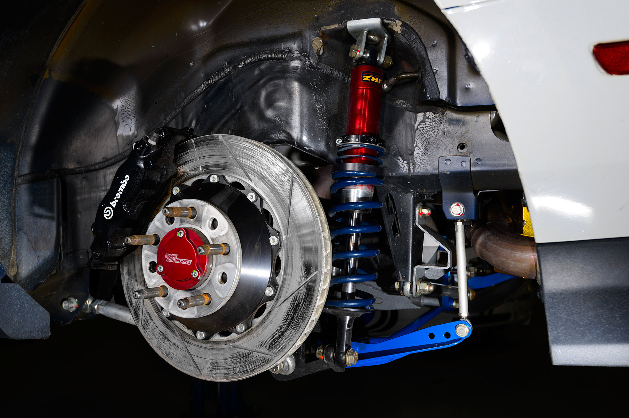 In the rear, four-piston Brembo calipers on unique brackets squeeze 355mm rotors mounted on custom-made aluminum hats.