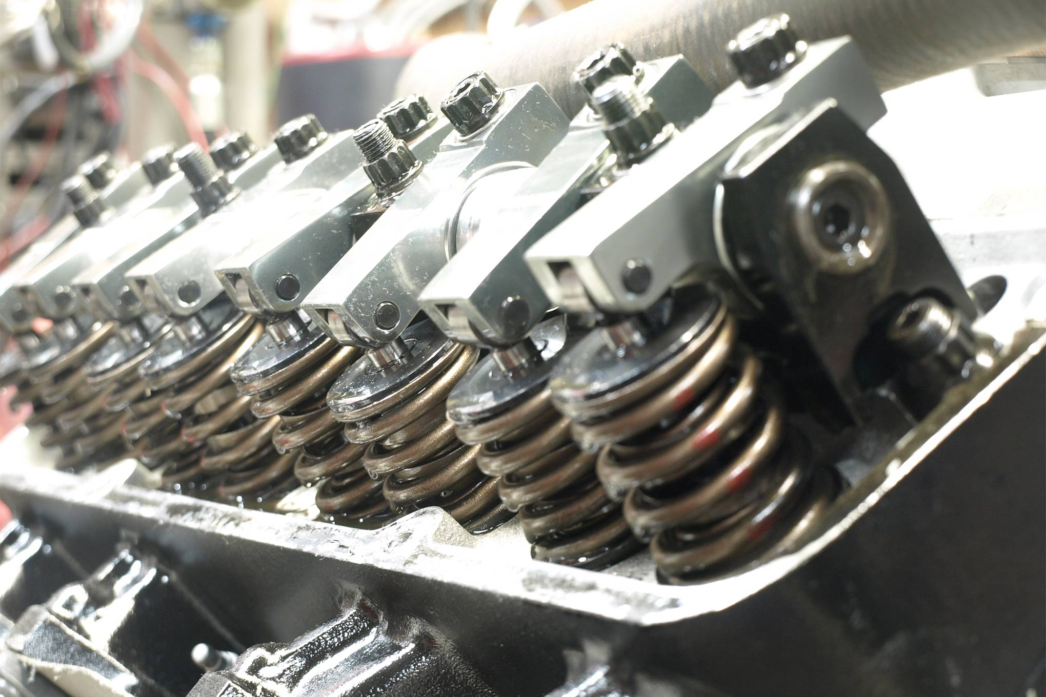 To suit the hefty hydraulic roller lifters, a set of Comp Cams double valvesprings (with dampers) replace the single-coil Edelbrock items. At 1.840-inch installed height, they deliver 165 pounds on the seat and 430 pounds at 0.557-inch lift. The Edelbrock valves and chrome-moly retainers are reused. The 1.76:1 aluminum roller rockers are from Pro Comp (PN 261-1134) with lifter preload set at 0.040-inch (3/4 turn on each adjuster past zero lash).