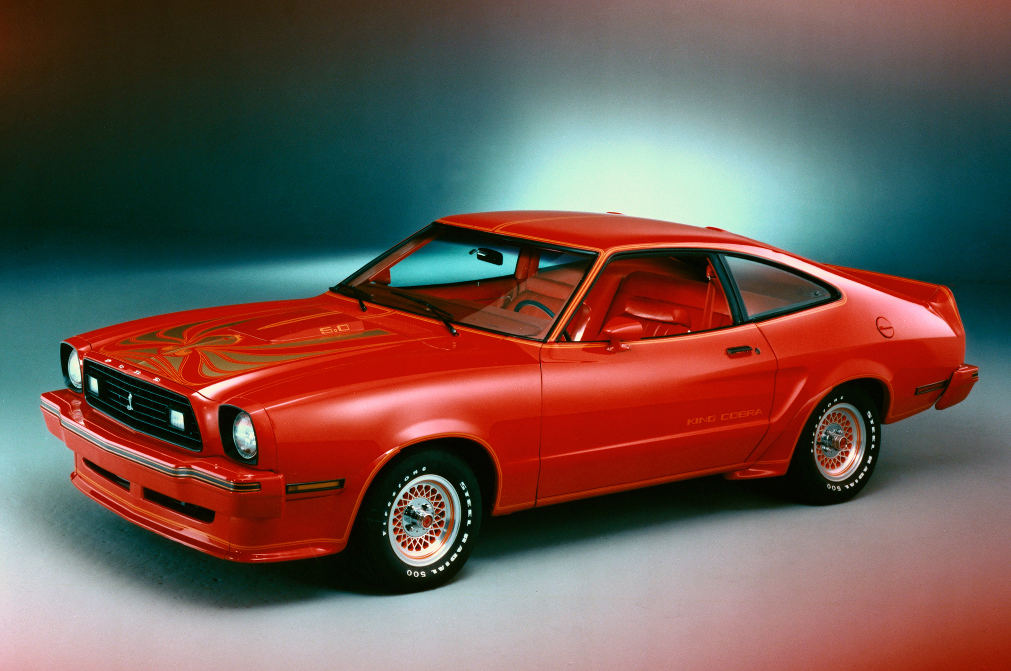 In an effort to spike Mustang sales, Ford conceived the 1978 King Cobra, which was surely a cut above Cobra II. King Cobra was decked out with a front air dam and groovy hood graphics along with a scoop just to make sure the performance message was delivered. There were also suspension improvements to punctuate the message. The best Ford could come up with was 134 hp from the 302ci V-8.We like the lacy spoke wheels, white letter tires, slippery body, heavy-duty suspension, and the King Cobra's hot demeanor. Ford sold 4,318 King Cobras early in 1978, which were priced at $5,638.