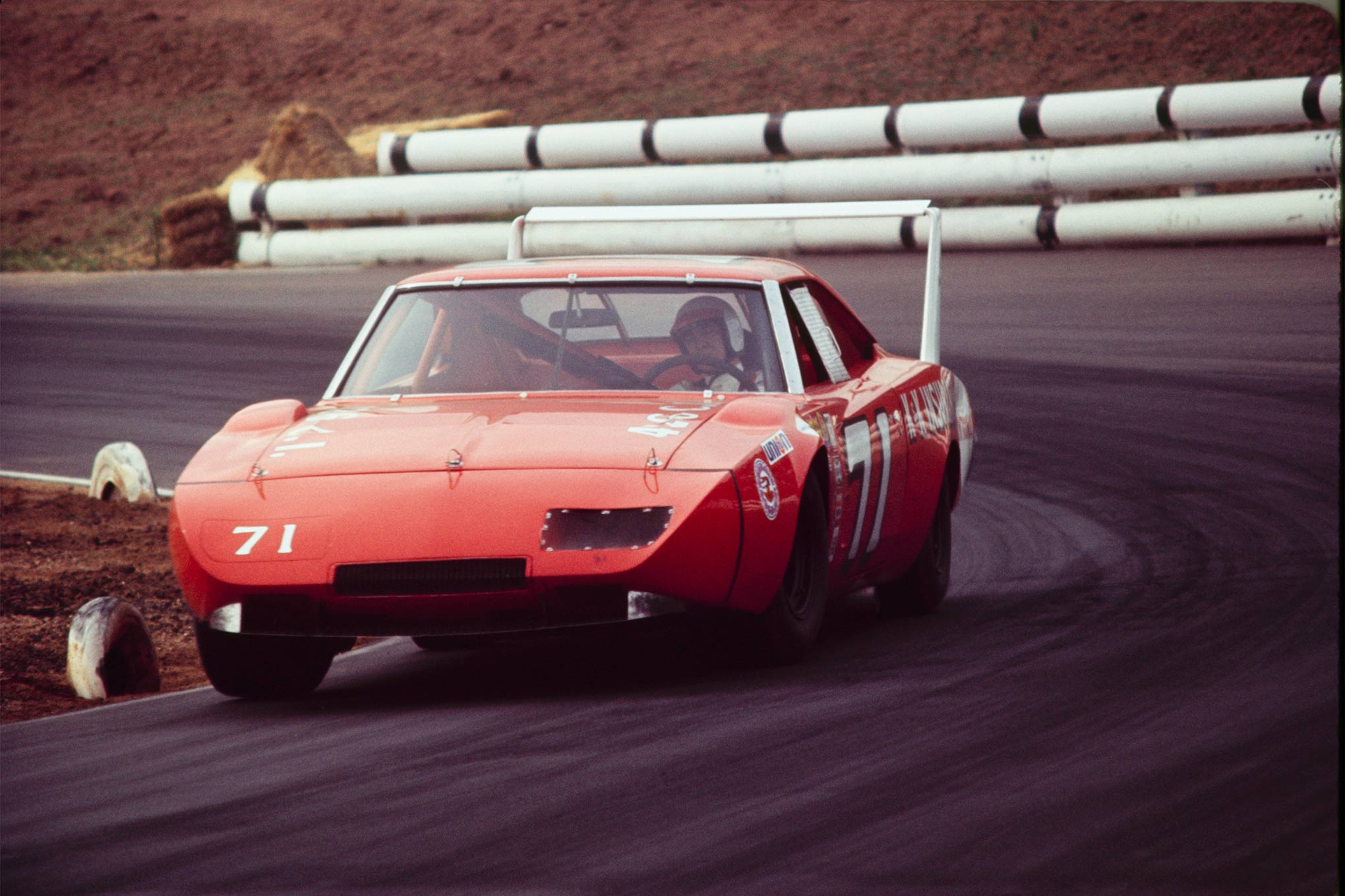Sawing through the turns at the 1971 Motor Trend 500 at Riverside International Raceway, where after 191 laps Bobby Isaac and the Daytona came in Fourth Place. Only 12 of the 40 starters finished the race.