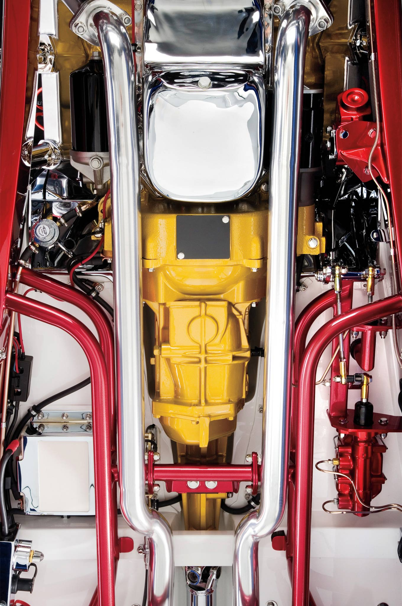 This perspective shows where the fabricated exhaust manifolds feed the exhaust pipes. It also reveals how the Corvair box mounts and where the battery lives (lower-left corner of photo).