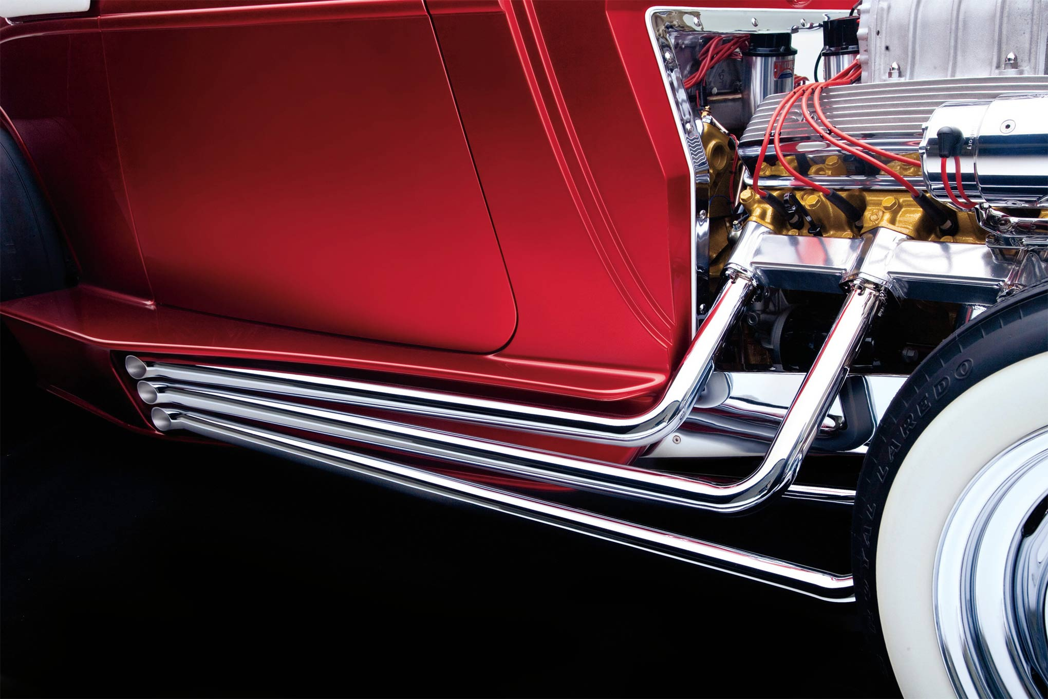 Martinez built eight pipes for the car: the muffled ones that tuck under the chassis and these dummy pipes that fill the side coves.