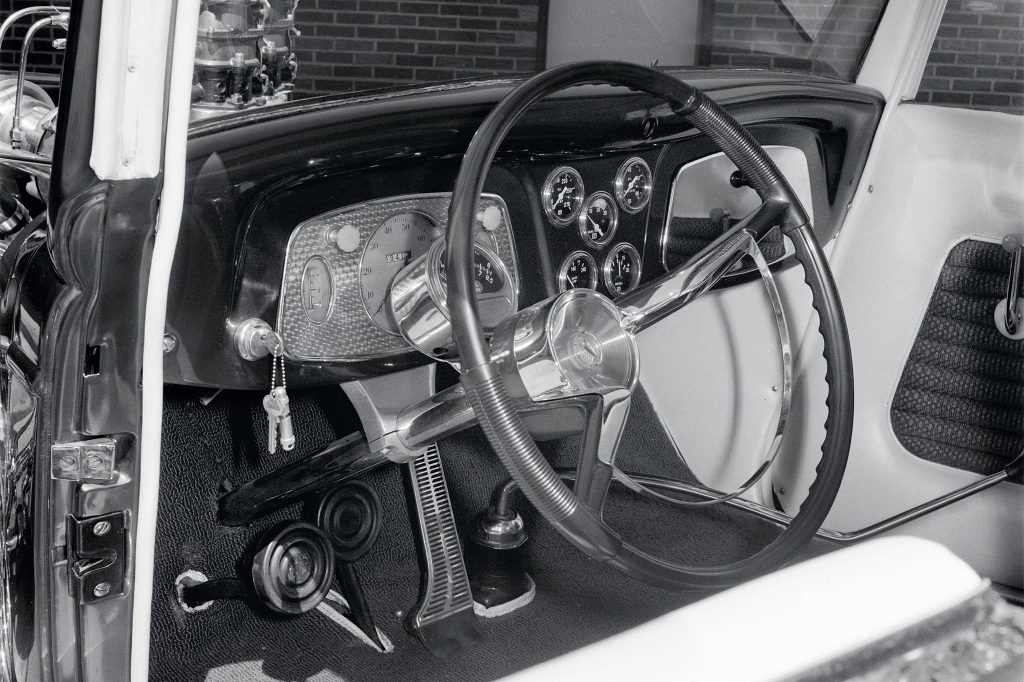 """Vinny's Interiors in Doylestown trimmed the car in pearl white leatherette. """"The red material we had was from another job,"""" Borneman says. """"We showed him the pictures, he said, 'I got the perfect stuff.'"""" It came from a '60 Plymouth."""