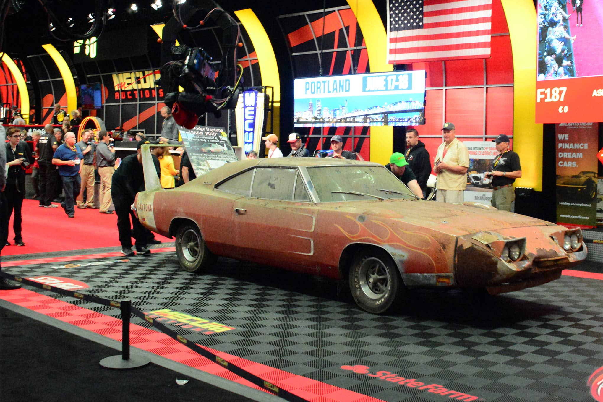 Here is where the journey of Mecum Lot F186, the barn find Charger Daytona of Charlie Lyons, came to its conclusion: on the platform with a winning bid of $90,000.