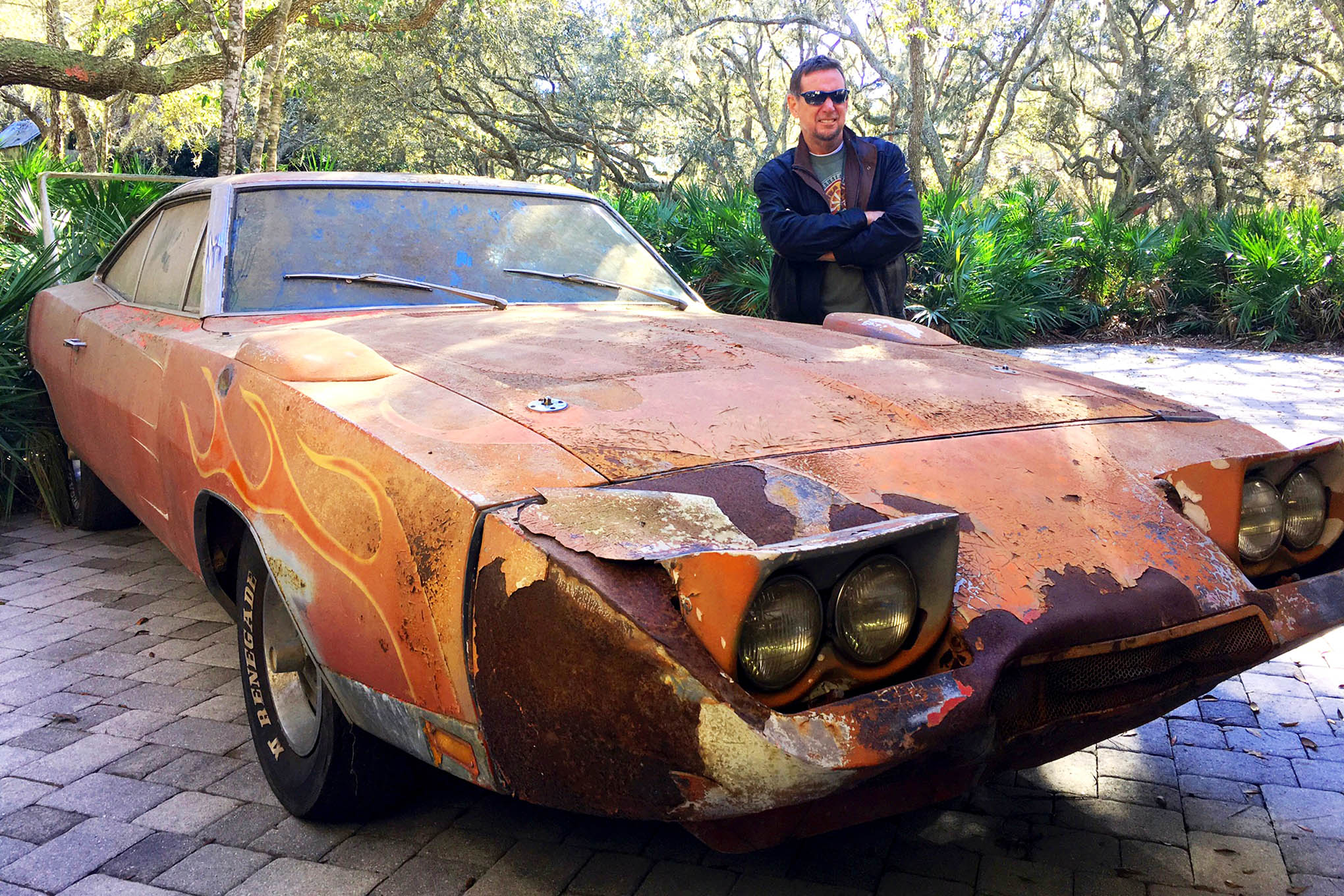 Dr. Jim Norman poses with his new 1969 Dodge Daytona Charger barn find that he snatched up at Mecum's Kissimmee auction last weekend. Norman's family is elbow-deep in Dodge history; his family was in the Dodge retail business in the '60s and '70s, in Florida, during the peak of the NASCAR aero wars. Who better to preserve this piece of history?