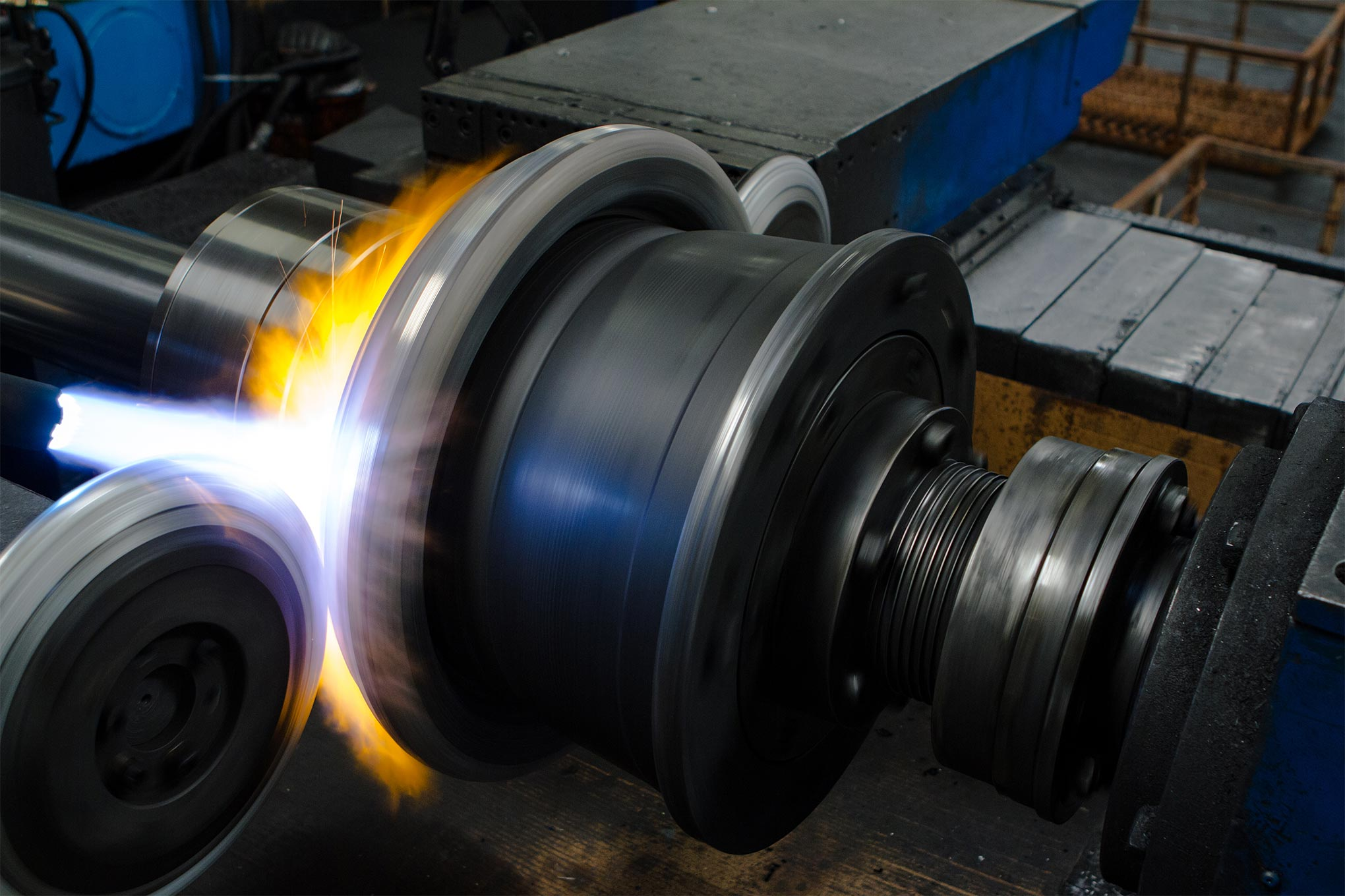 The flattened forged discs are then installed on a spin-forging machine—basically, an enormous horizontal pottery wheel—that squeezes the aluminum wheel into shape.