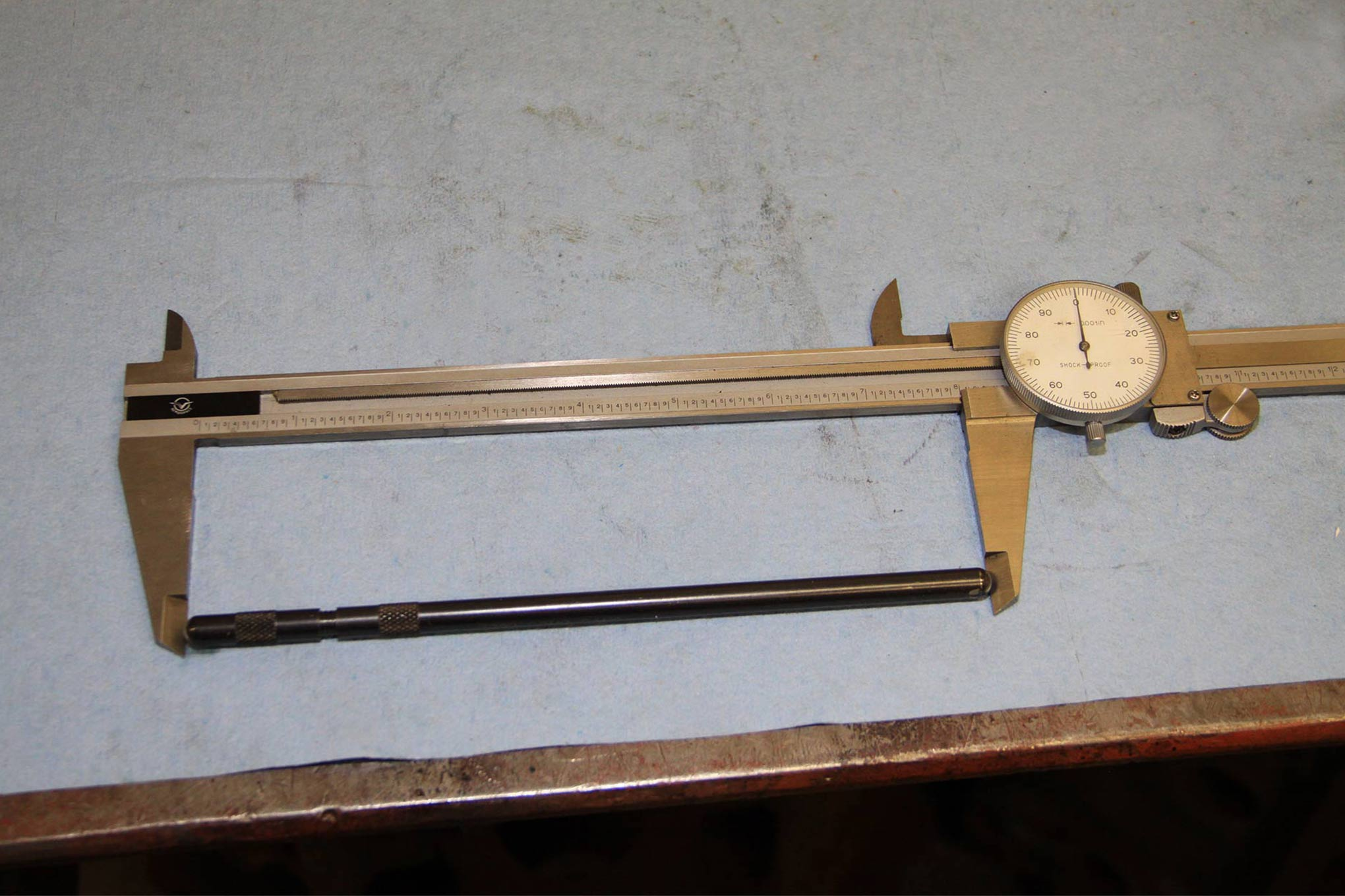 With the pushrod length determined it can be measured with a dial caliper.