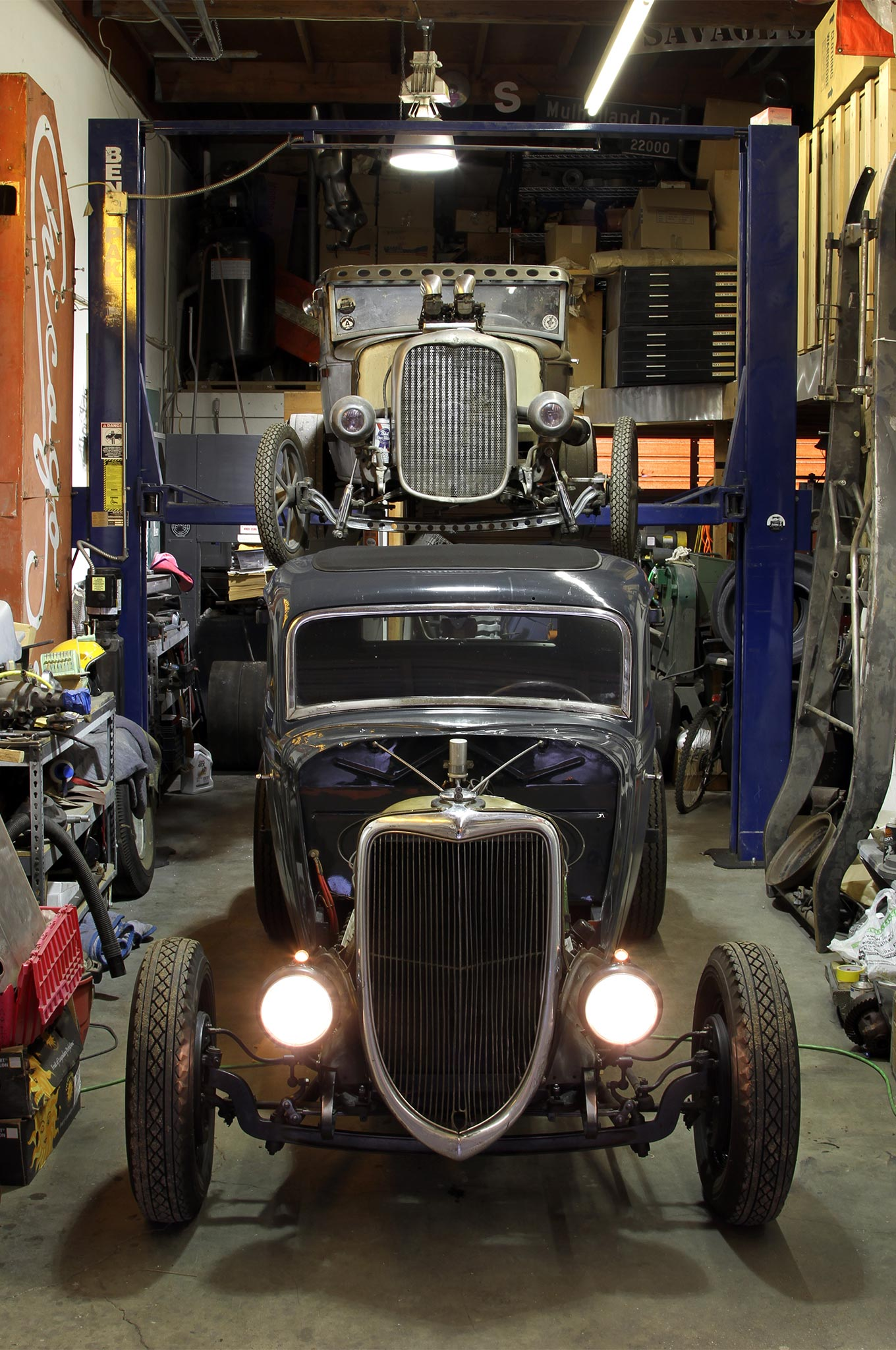 Aaron's workshop is quite small, but there's enough room for the '34 coupe and his '30 Model A coupe. The shop is also filled with all sorts of vintage race car and hot rod parts, plus an abundance of old neon and other automotive related signage.