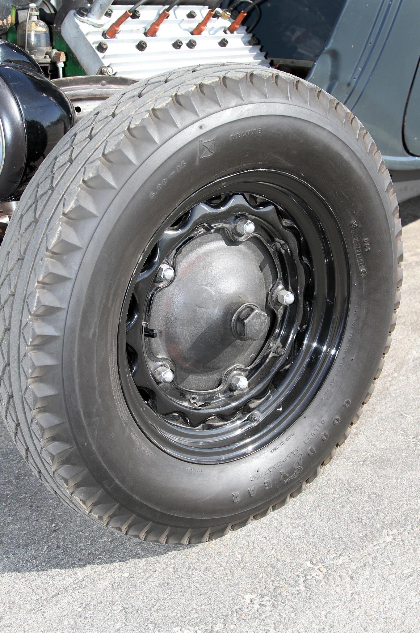 """The '34 uses the brakes from a '39 Ford. The brake drums are in the """"wide five"""" bolt pattern, which require using the wheels from a '39 Ford as well. The hubcaps were left off for a more aggressive look. The wheels for the front are 16s with vintage style Goodyear 6.00-16 tires. The rear wheels are 18s with 7.00-18 tires from Specialty Tires of America."""