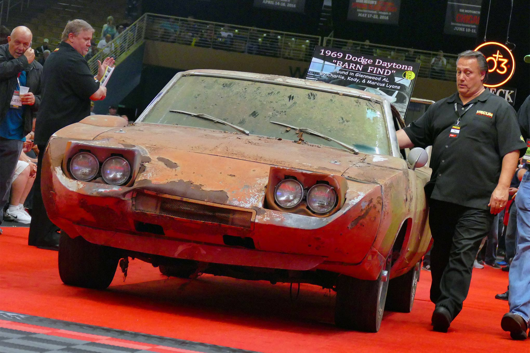 With an ask of $95,000 and the reserve off, the car was moved onto the final block of the stage, where the deal gets done. Indeed, it had already hammered to a final bid of $90,000 by the time it had been stopped via the Fred Flintstone method. Photo Credit: Joel Stunkard