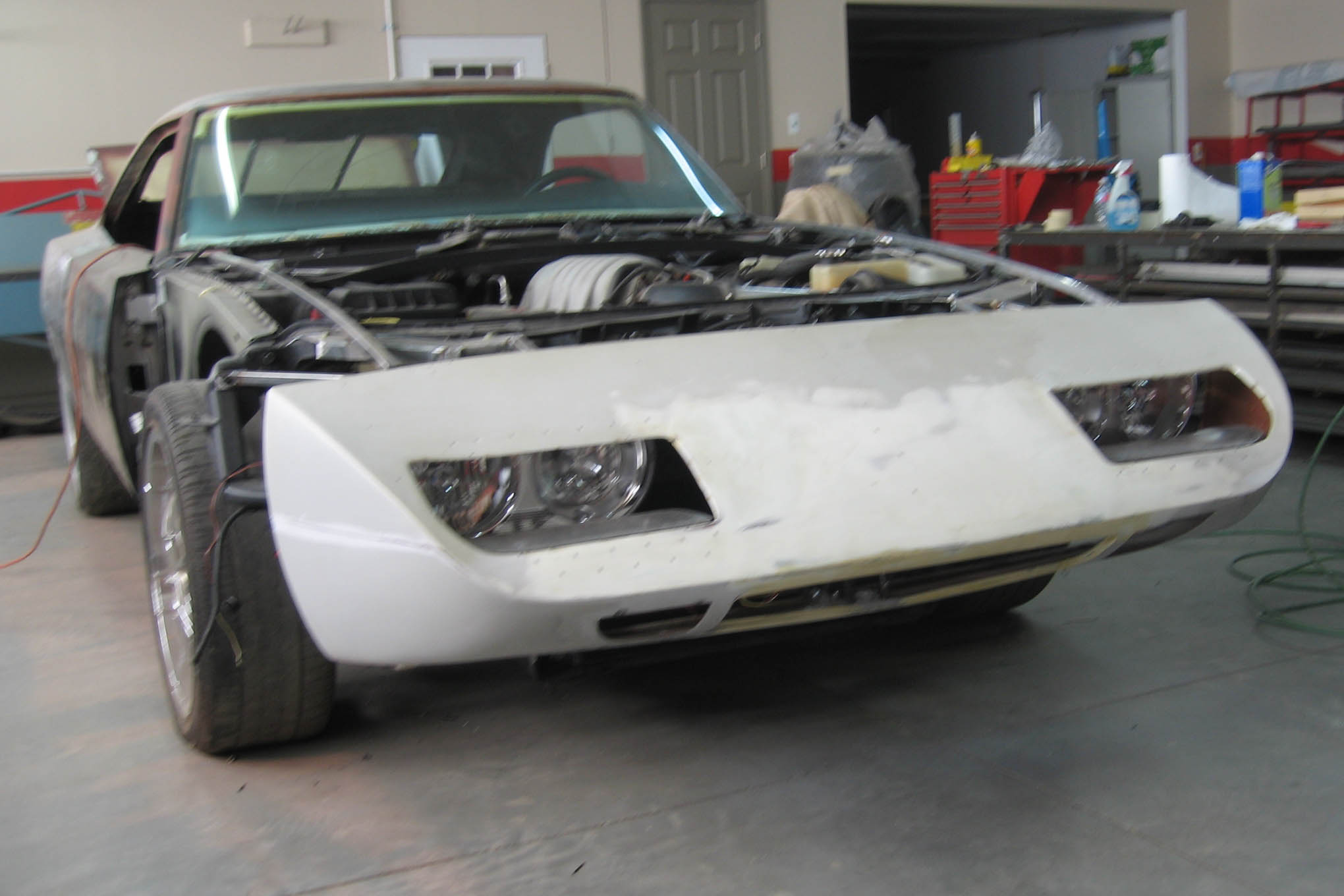 "Note how the telltale rectangular ""Daytona"" screen at the leading edge of the nosecone is gone, now sealed up like a Superbird, and taking air in through the lower valence. At this point in the project, Mirabelli was working out final details on the operation of the mechanical headlight doors."