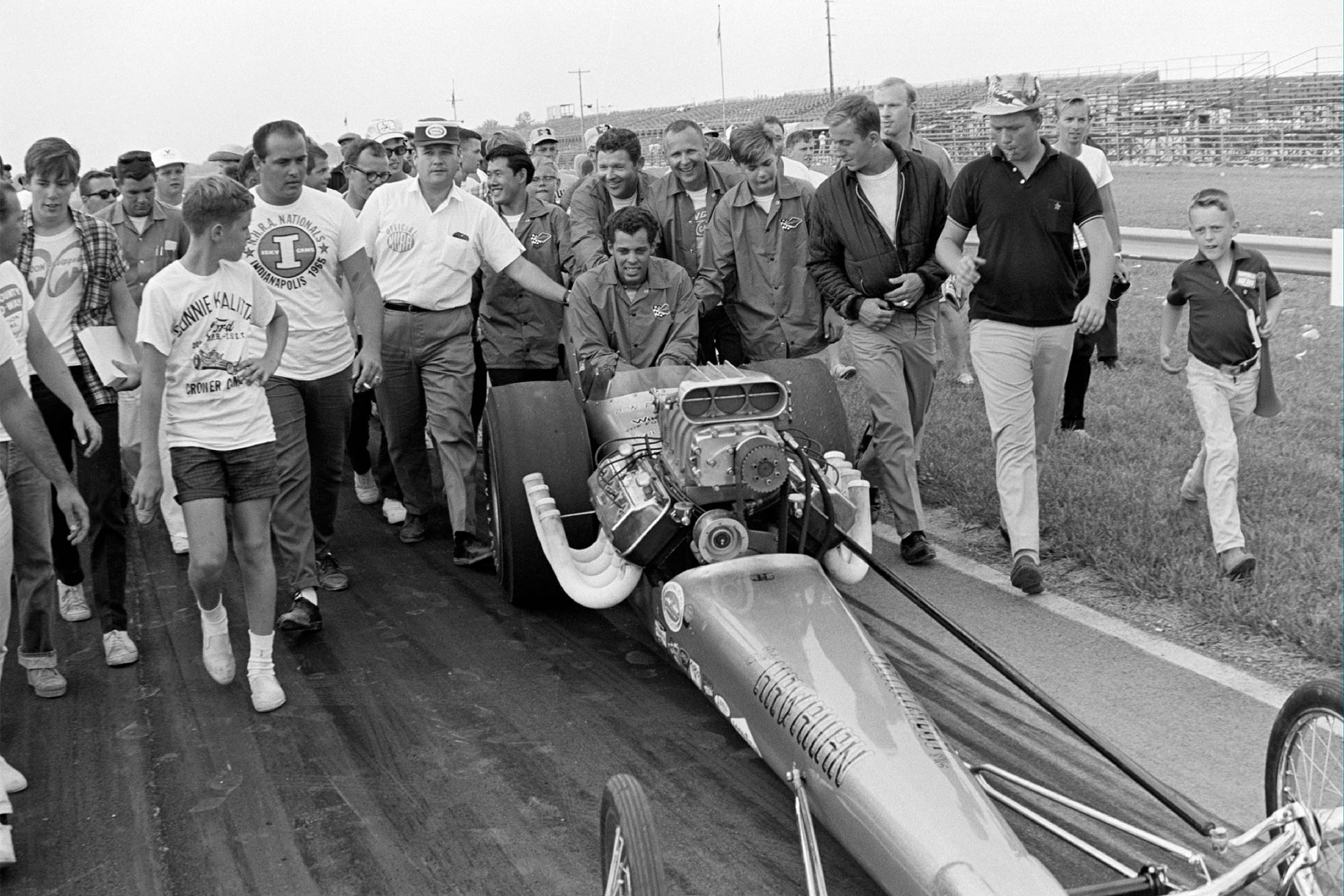 The scene of smiles immediately after winning the final round at the 1965 Indy Nationals.