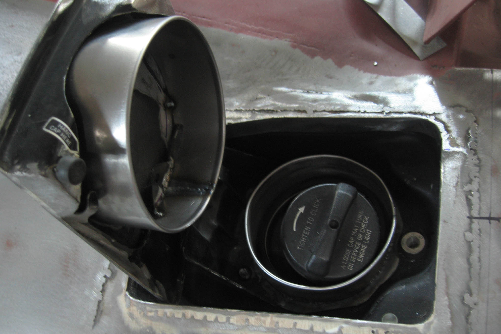 "To put ""know-it-alls"" off guard, Mirabelli eliminated the classic Dodge Charger flip-top chrome cap, and replaced it with a trap door of his own design. This more closely mimics the fuel door on the current model, but places it atop the quarter-panel flanks instead of on the side, like a late-model car."
