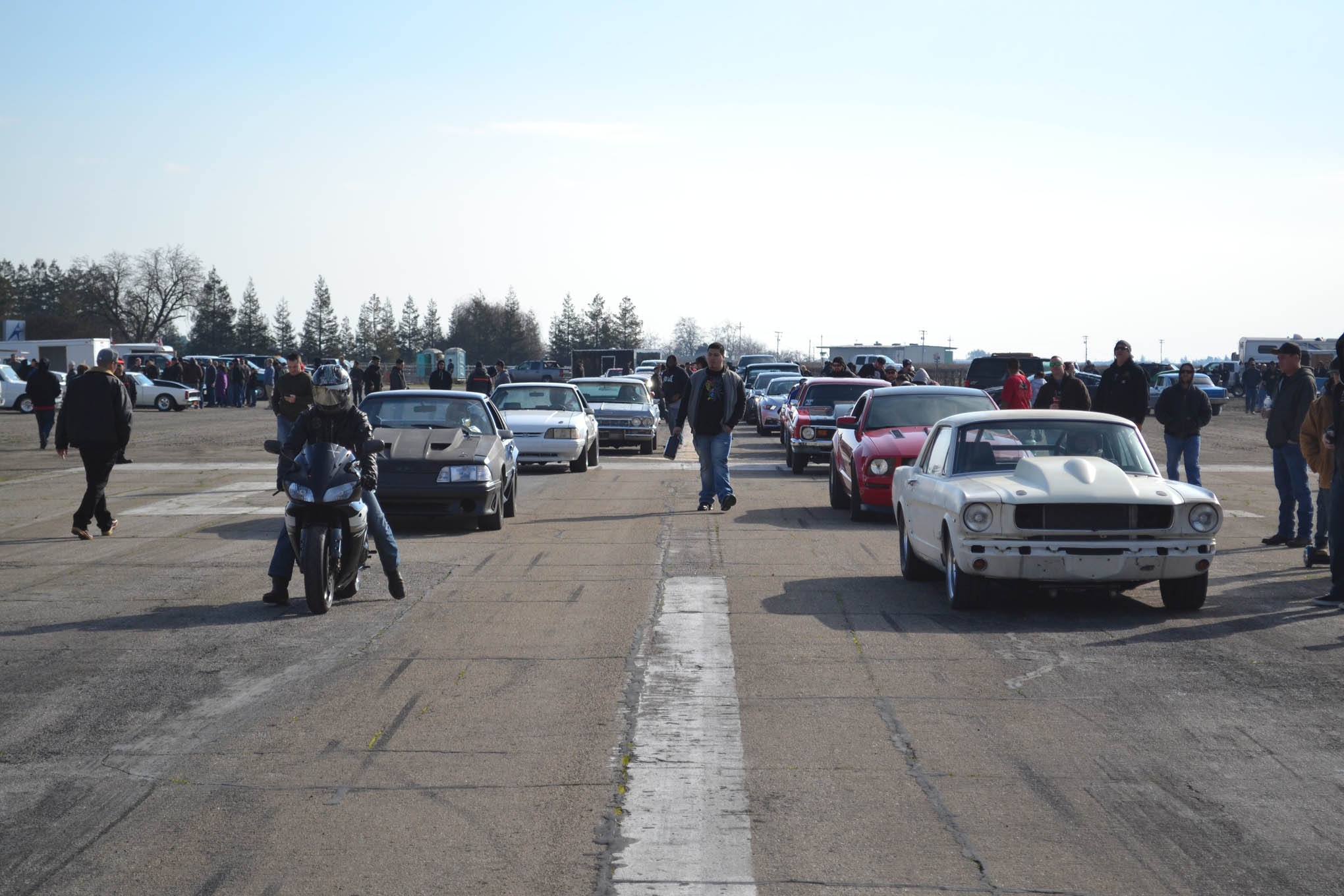 The pairings in an event like the Kingdon airstrip drags can be quite interesting. In the left lane, a road-race-style, twin-turbo LS Mustang (that put down 750 hp to the tires) would be taking on a street bike. The winner? Thanks to traction issues with the Mustang, the bike took the win.