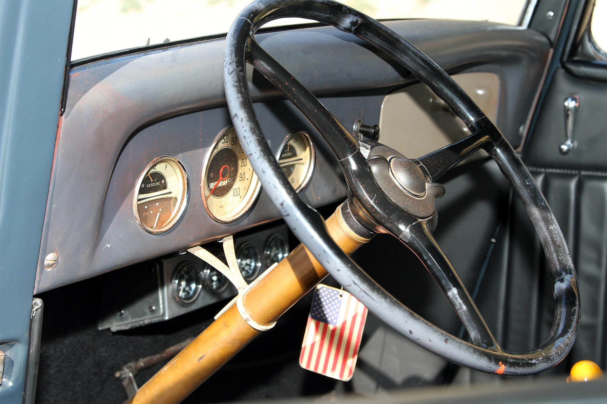The dash for the hot rod is from a '36 Chevy school bus. The gauges are old AC-brand monitors that Aaron got from a dry-lakes racer. Under the dash, Aaron fabricated a gauge box to house four Stewart-Warner gauges. The box is tucked deep under the dash so it's not that visible from the outside. An original '34 Ford steering wheel and column were also used in the coupe.