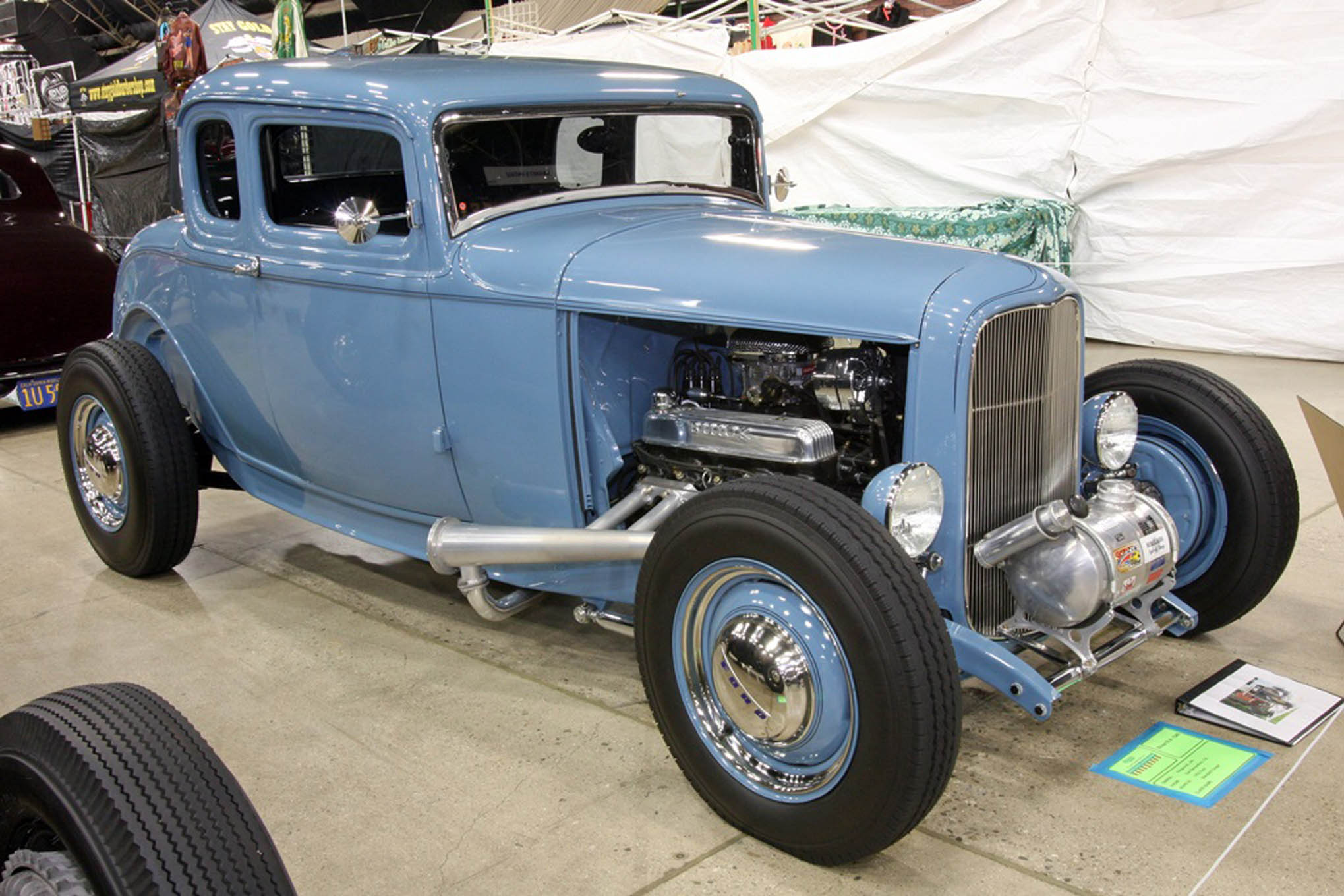 More nice low-key pinstriping can be found on Jim Siegmund's light blue 1932 highboy coupe from San Bernardino. Traditional details like the Moon tank, split 'bones, quick-change rearend, and megaphone headers are just right, and the Buick Nailhead is a great engine choice.