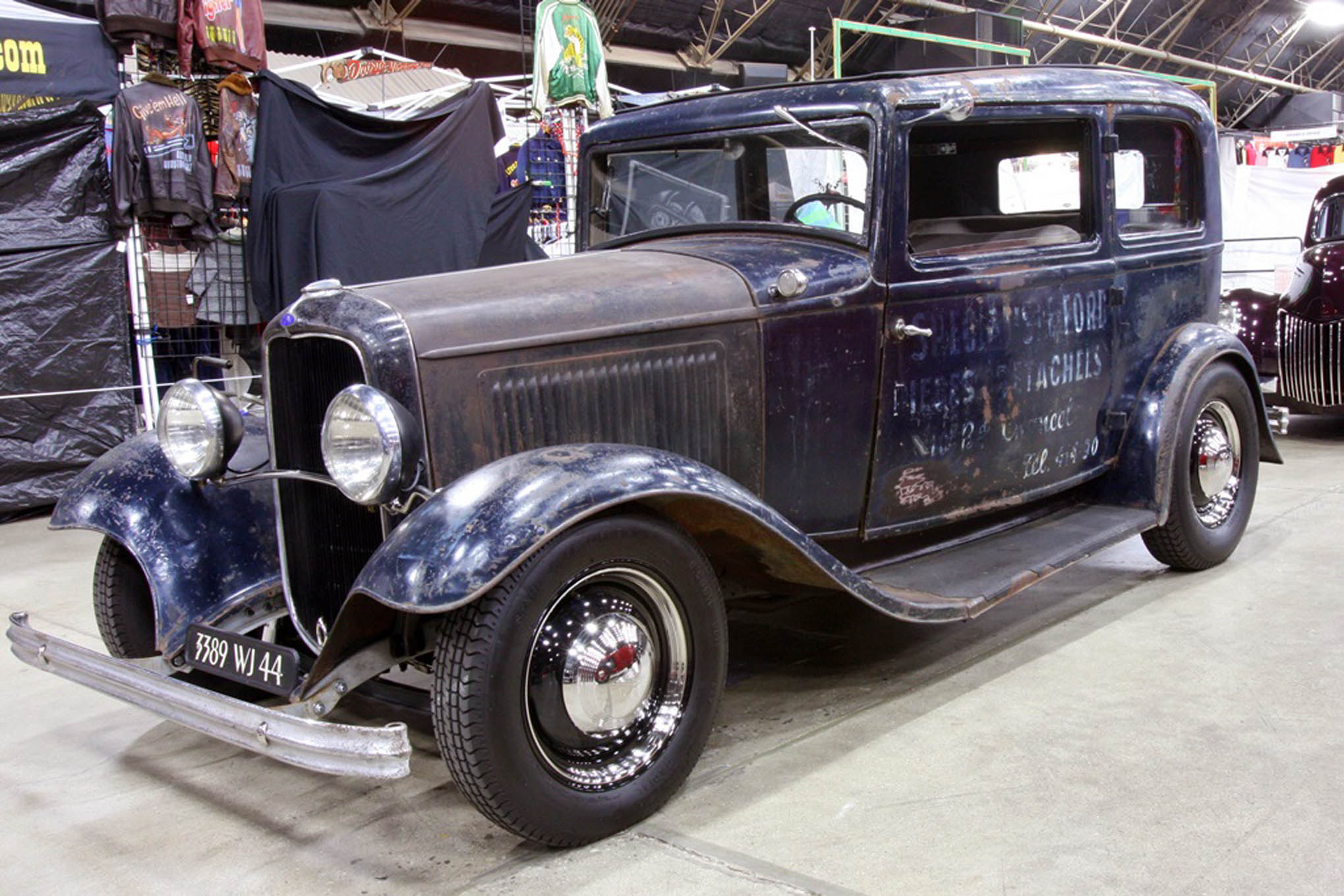 """You can kind of still read the 60-year old graphics on even older paint on Steven Szantai's 1932 Ford European model Tudor, but if you don't know French you'd miss that """"Specialist Ford Pieces Detachees"""" was advertising spare parts. Don't even bother calling the old five-digit number. The genuine survivor runs a 239ci French military Flathead"""
