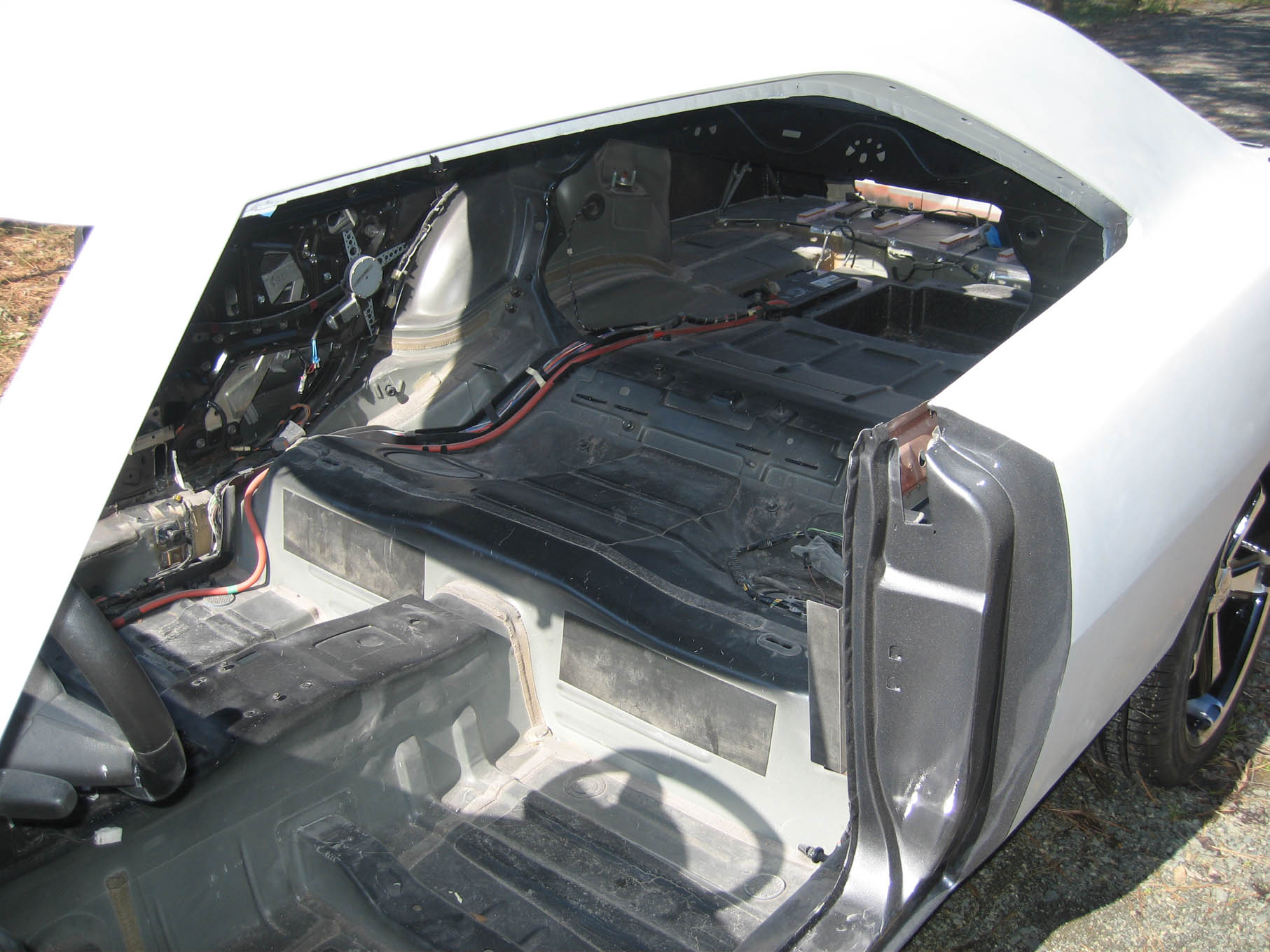 Inside, you'll see mostly late-model sheetmetal, right down to the battery well in the trunk. Check out the door jamb. Mirabelli has untold hours of labor in this area of the car because the outside door skin is vintage, but the inside a combination of late-model LX, and Mirabelli's own design.