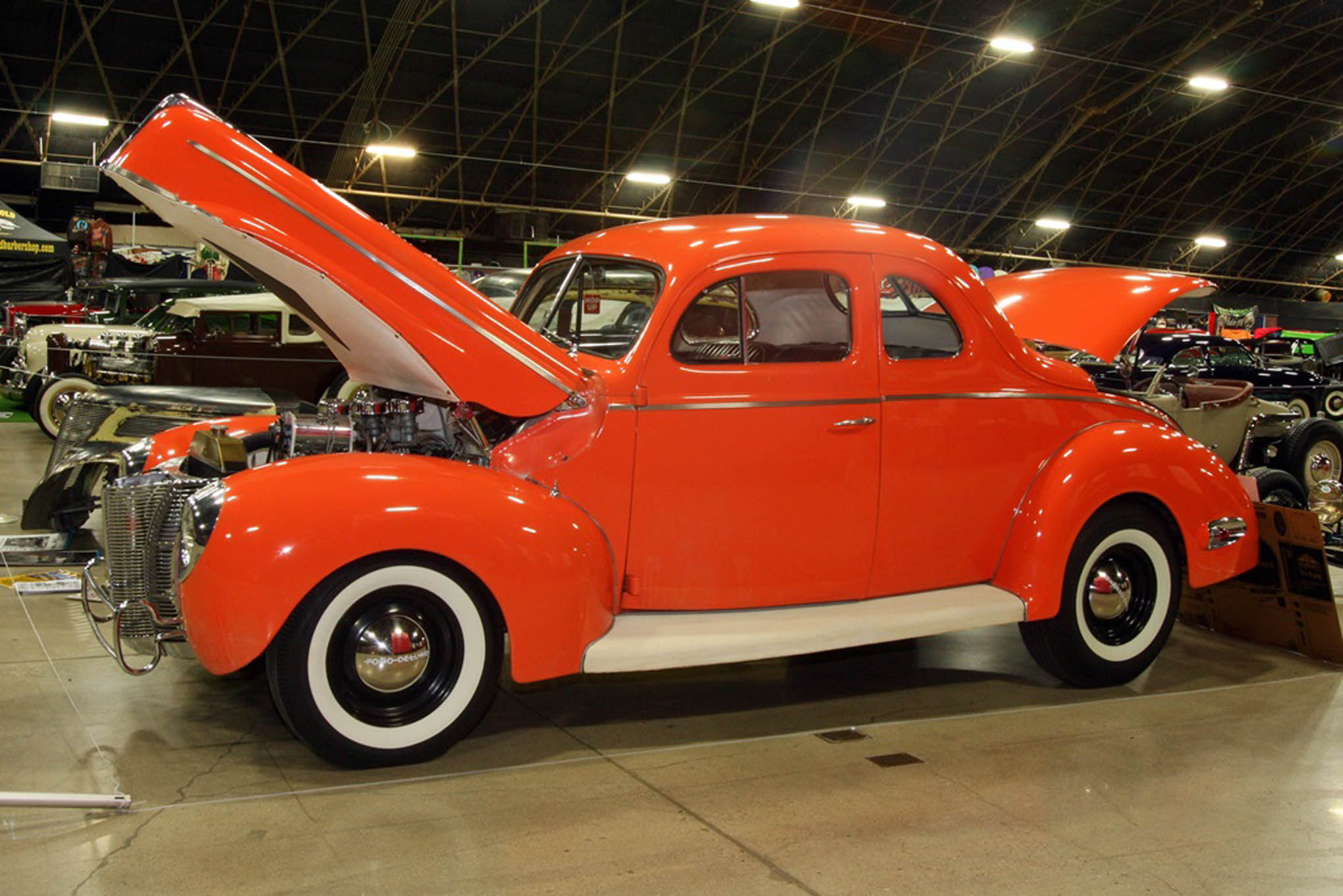 More history. Mike Wetherell bought this 1940 Ford coupe in 1957 and built it as you see it. The car was shown and raced, and sold in 191. After making the rounds for half a century it recently came back to Mike and is being restored to its '50s condition, with a tri-power Olds. We're told those are still the same tires.