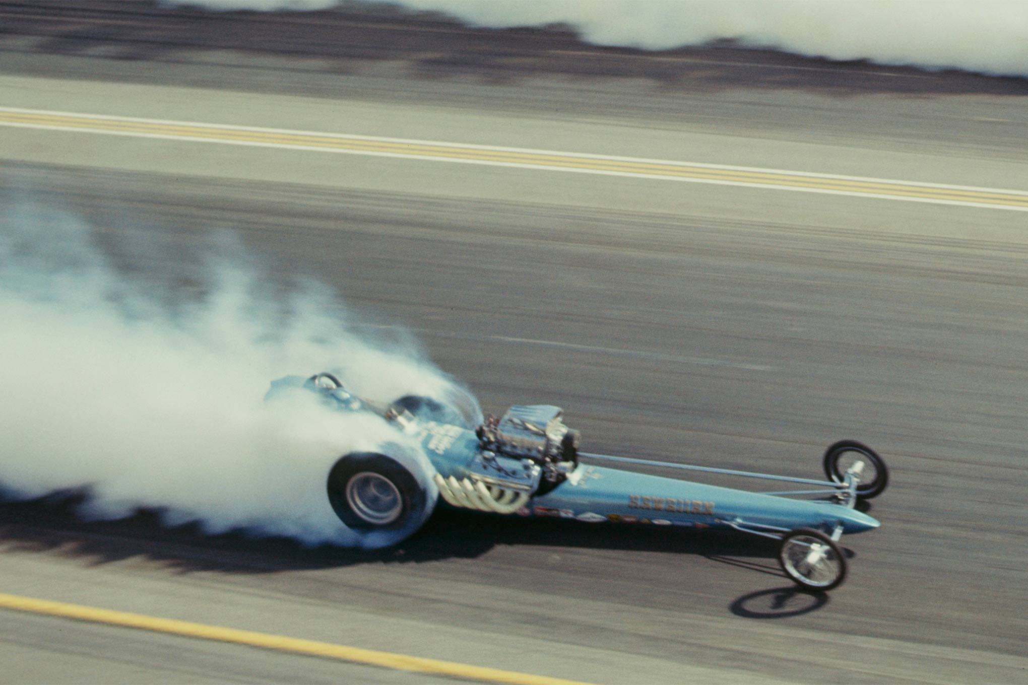 Final round spinning the hides at the 1966 NHRA Nationals shoed by Mike Snively.