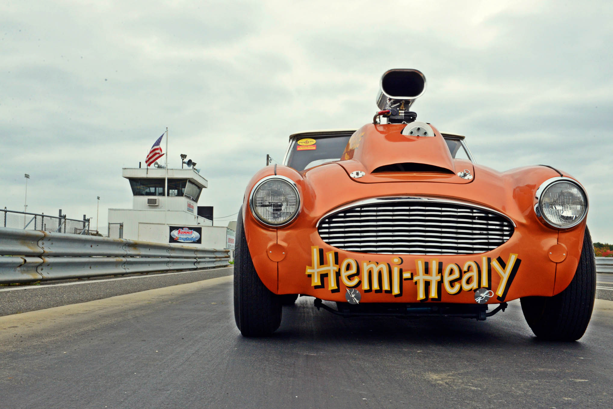 "Many theories on the misspelling of Healey [sic] on Bob's race car abound, but to him, the answer is pretty simple. ""Misspelling Healey was just a way of me signifying that we follow our own path here,"" Bob says."
