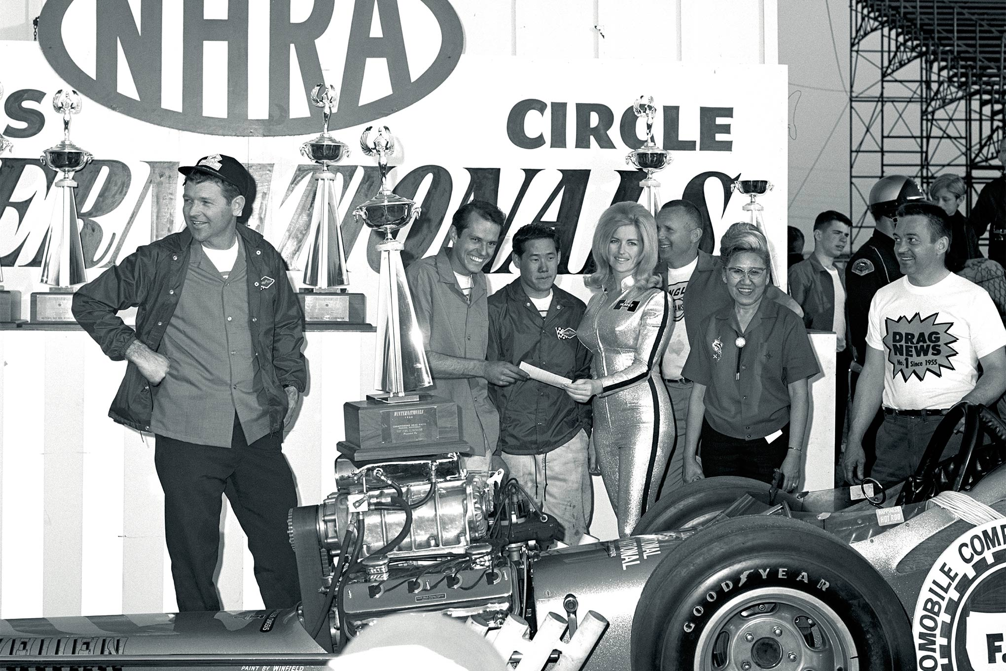 Mike Snively getting his winning check from Miss Hurst Linda Vaughn at the 1966 NHRA Winternationals. From left are Keith Black, Snively, Leong, Vaughn, Hanson and Roland's mom Teddy.
