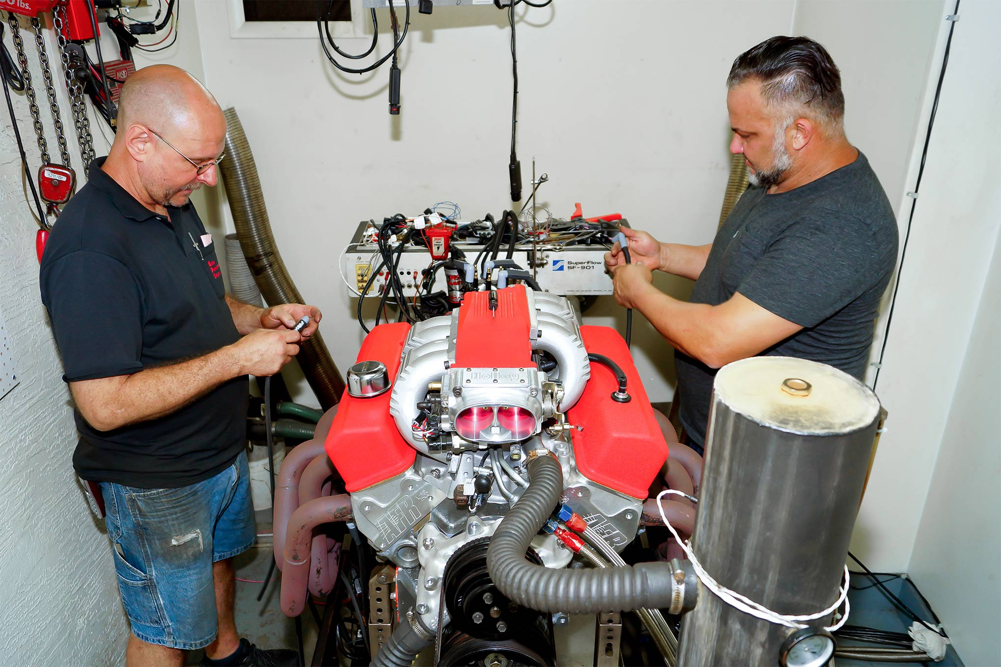 With the new 383 assembled, it was off to Automotive Performance Engineering in Auburndale, Florida, where proprietor Kevin Willis (at left) would put the stroker through its paces. In addition to building the engine, Antivenom's Greg Lovell (at right) assisted in getting the engine mounted up and took care of last-minute details like the new spark-plug wires.