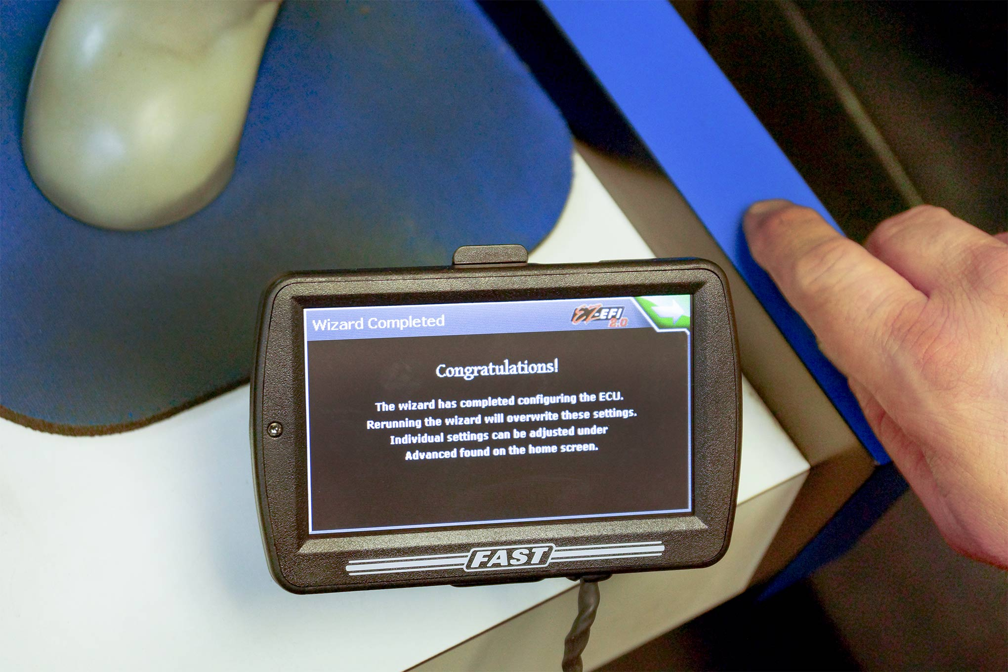 With the engine's exhaust, fuel, and cooling systems connected, it was time to run through the setup menu on the FAST EZ EFI 2.0 touchscreen. It's very easy to use, and before long, the TPI was alive and idling easily.