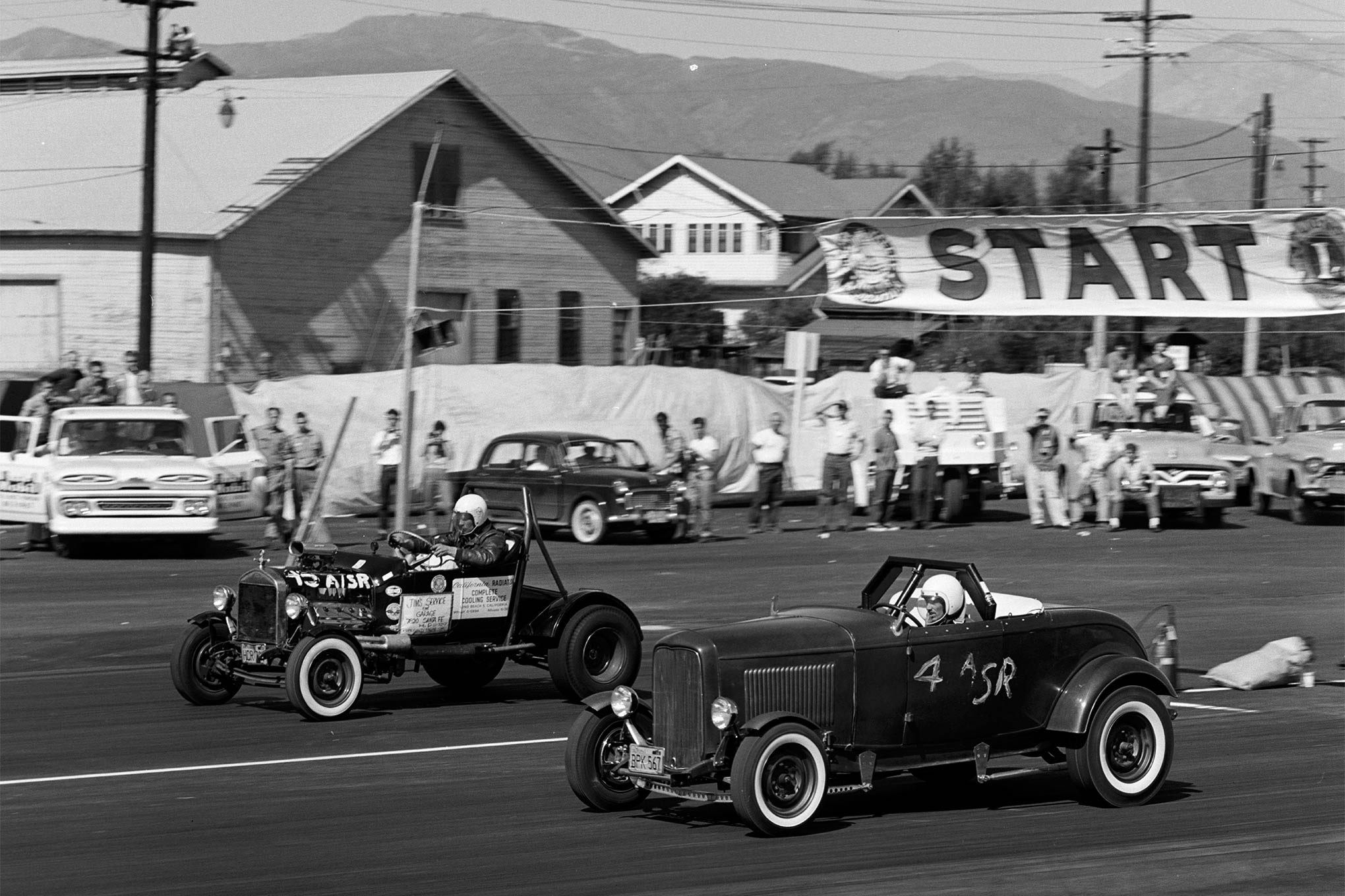 The man that would go on to start Street Rodder magazine 10 years later is Tom McMullen in the near lane in his pre-flamed Deuce roadster running in A Street Roadster against Jim Cassedy in his blown Chrysler T roadster. Cassedy would go on to win the class.