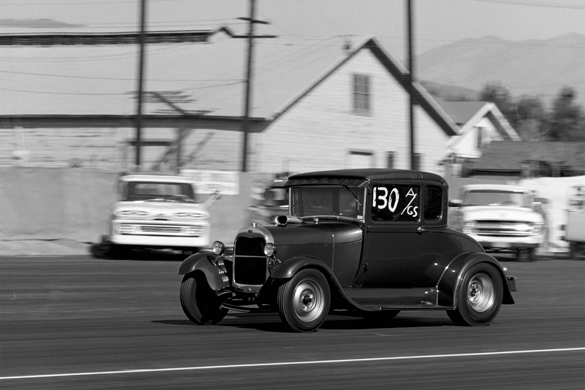 Another famous name in drag racing, Joe Pisano, in his 1929 Model A coupe, getting an A/Gas class win in the Little Eliminator races.