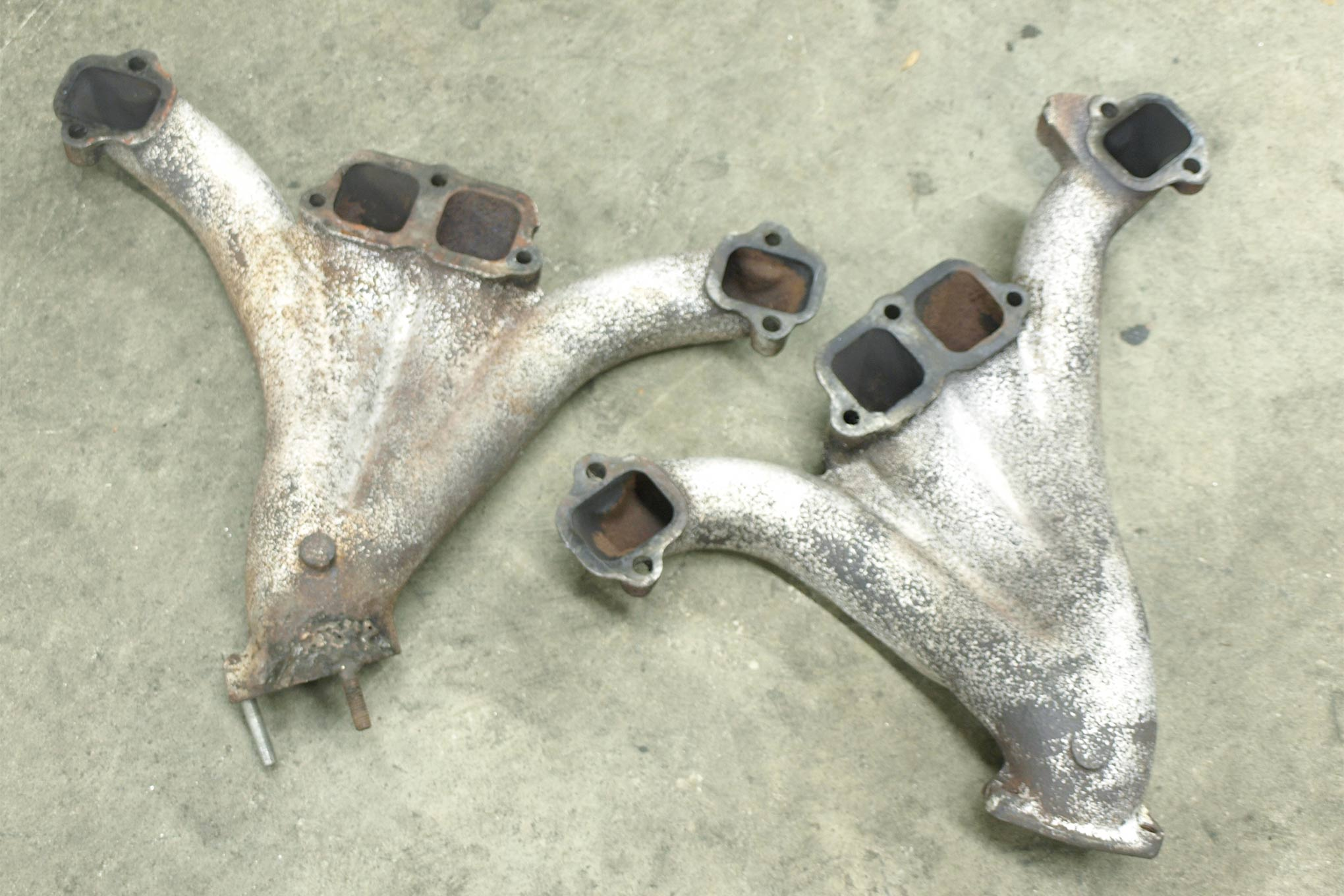 Like the competing Ford 427, Pontiac 421 Super Duty, and Mopar 426 Max Wedge, Chevy whipped up a nifty set of high-flow cast-iron exhaust manifolds for its early 1960s Super Stock warrior, the 409. At 13.0 and 11.4 pounds (driver/passenger), they're lighter than they look. Several sources offer tube steel headers, and Bob Walla racing even makes aluminum copies of the stock iron castings for the ultimate in trickery. With thermal barrier coating applied inside, they're ready for daily use.
