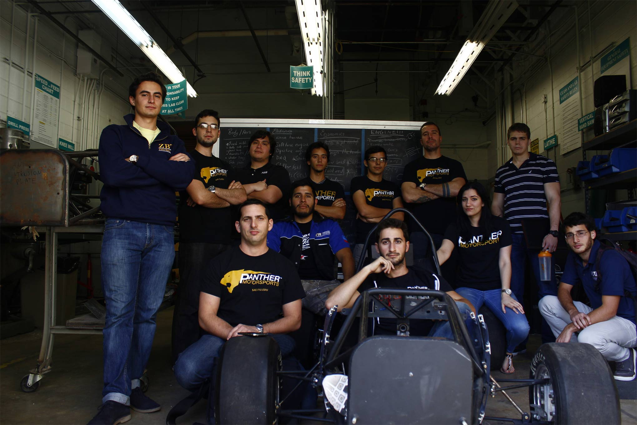 The FIU team, from left to right, starting at the back row: Juan Carrizosa, Hector Trujillo, Jose Tormo, Brian Garcia, Juan Trujillo, Juan Acosta, and Ryan Sheffield. Seated: Alain Fagundo, Luis Rojas, Victor Raymond (in the driver seat), Yussimil Libera, and Jorge Coria.