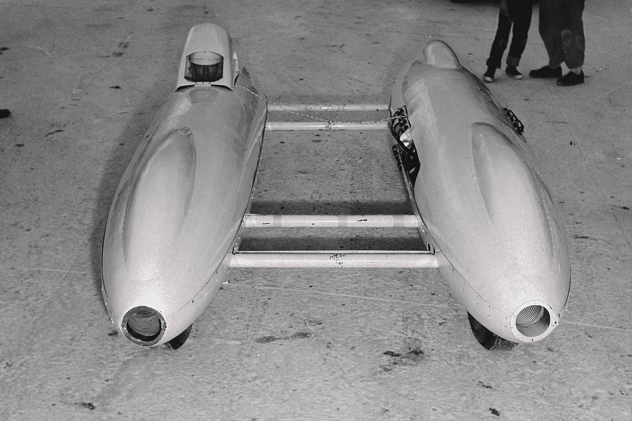 Tanks inspired countless ideas, not all of them good. Howard Johansen's twin-boom streamliner was one of the latter. Still, this second version with a 296-inch DeSoto did go 200. Driver Lloyd Scott had a thing for the unconventional: he owned and drove the twin-engine Bustle Bomb dragster.