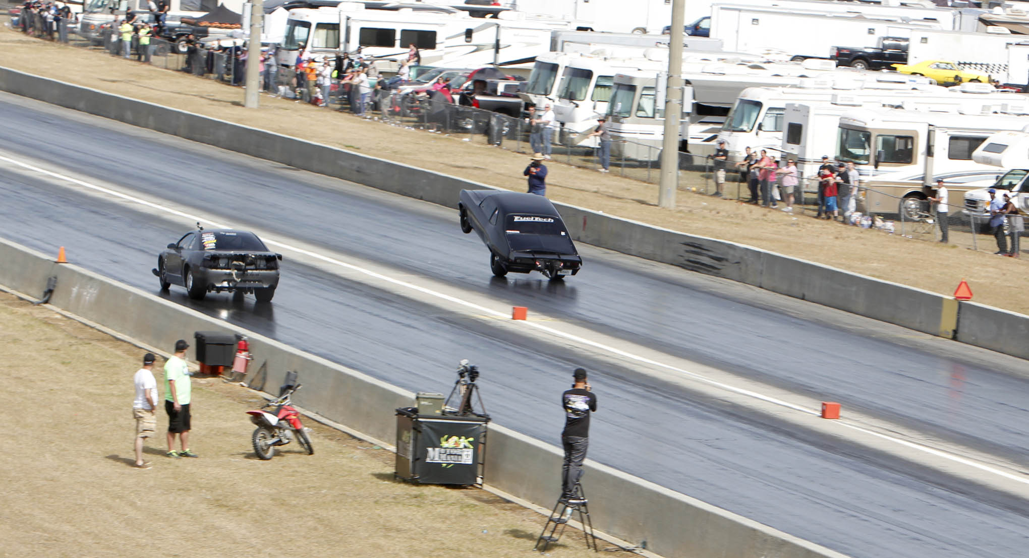 "Shawn Ellington made one of the craziest passes we've ever seen in front of a packed house Sunday morning. Ramping the power in after a soft launch, the ""Murder Nova"" started to pull the wheels just past the 60-foot line. He lifted to bring the front end back down, then rolled back into the throttle, and the car went into a second wheelstand. He crossed the finish line on the back wheels, winning that round of eliminations in Pro 275 with a 4.726 at 161.63 mph. ""There was no way I was going to pedal the car the second time the wheels came up,"" Ellington told us. He lost to class winner Barry Mitchell in the semifinals."