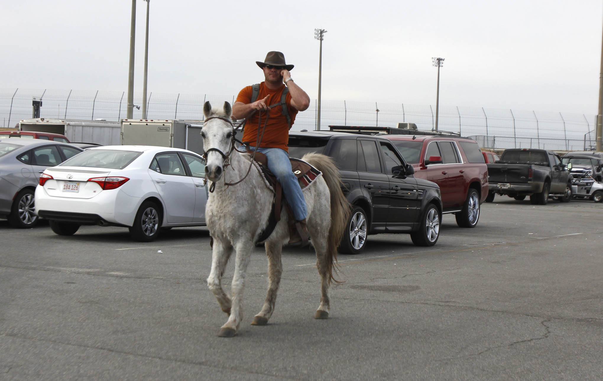 You just can't make this stuff up. We saw this dude riding around in the pits on his horse while yapping on his phone. We were so surprised we didn't even think to ask his name or what he was doing there. Email us with the details if know this guy.