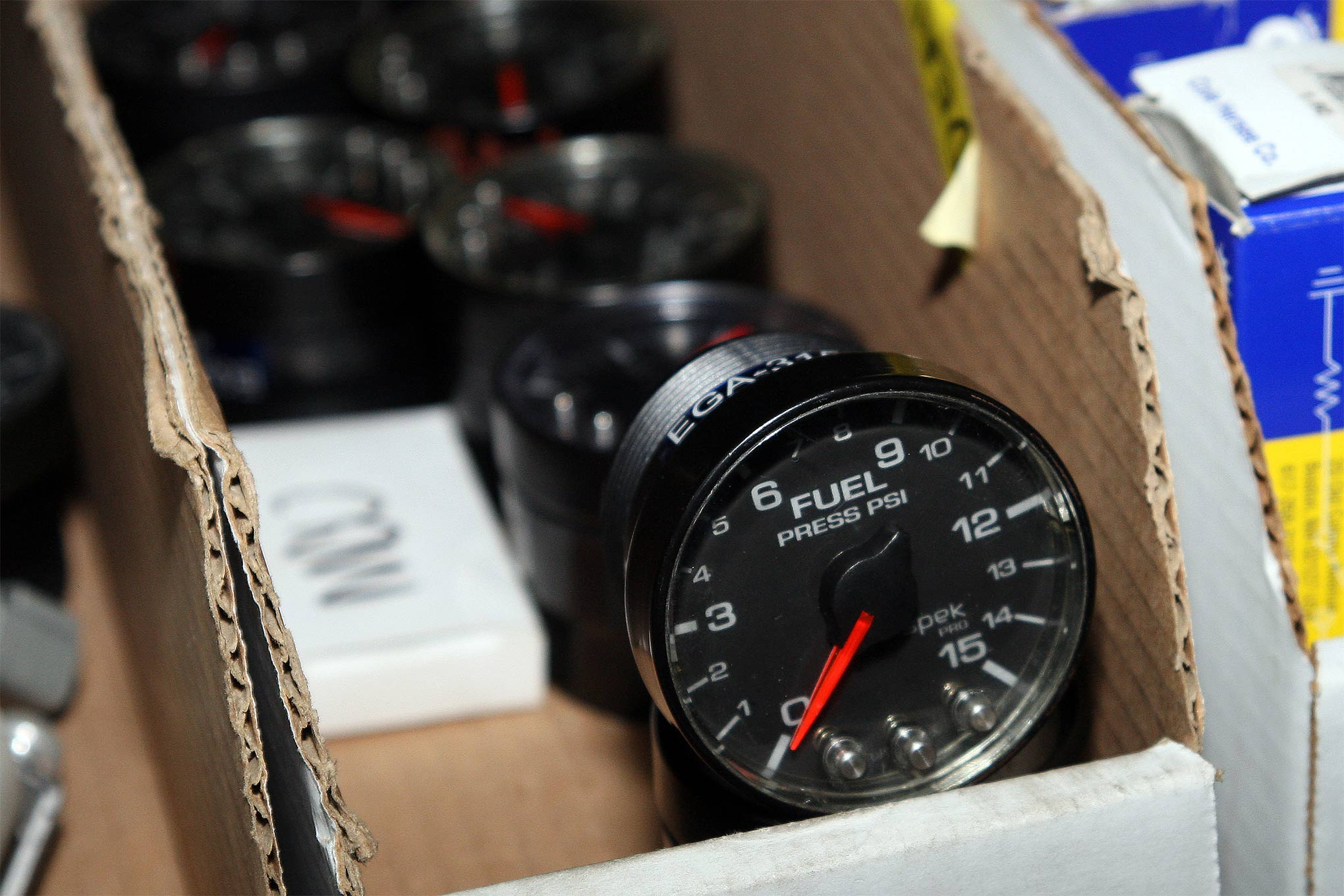Here is one of the best deals we've found. Now that NASCAR teams are moving to a digital dash, the gauges they formerly used are flooding the market. These Spec gauges by AutoMeter are lightweight and very high quality. You could put together a full dash from the used options. These fuel-pressure gauges were just one example. New, they sell for 250 dollars, but were available here for 25.