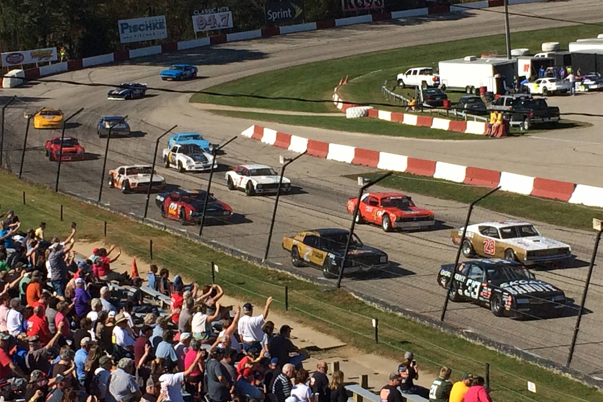Fans at LaCrosse salute the Vintage racers before the Oktoberfest feature. A total of 23 cars were on hand, one of the best-attended Vintage races in past few seasons in the Midwest.