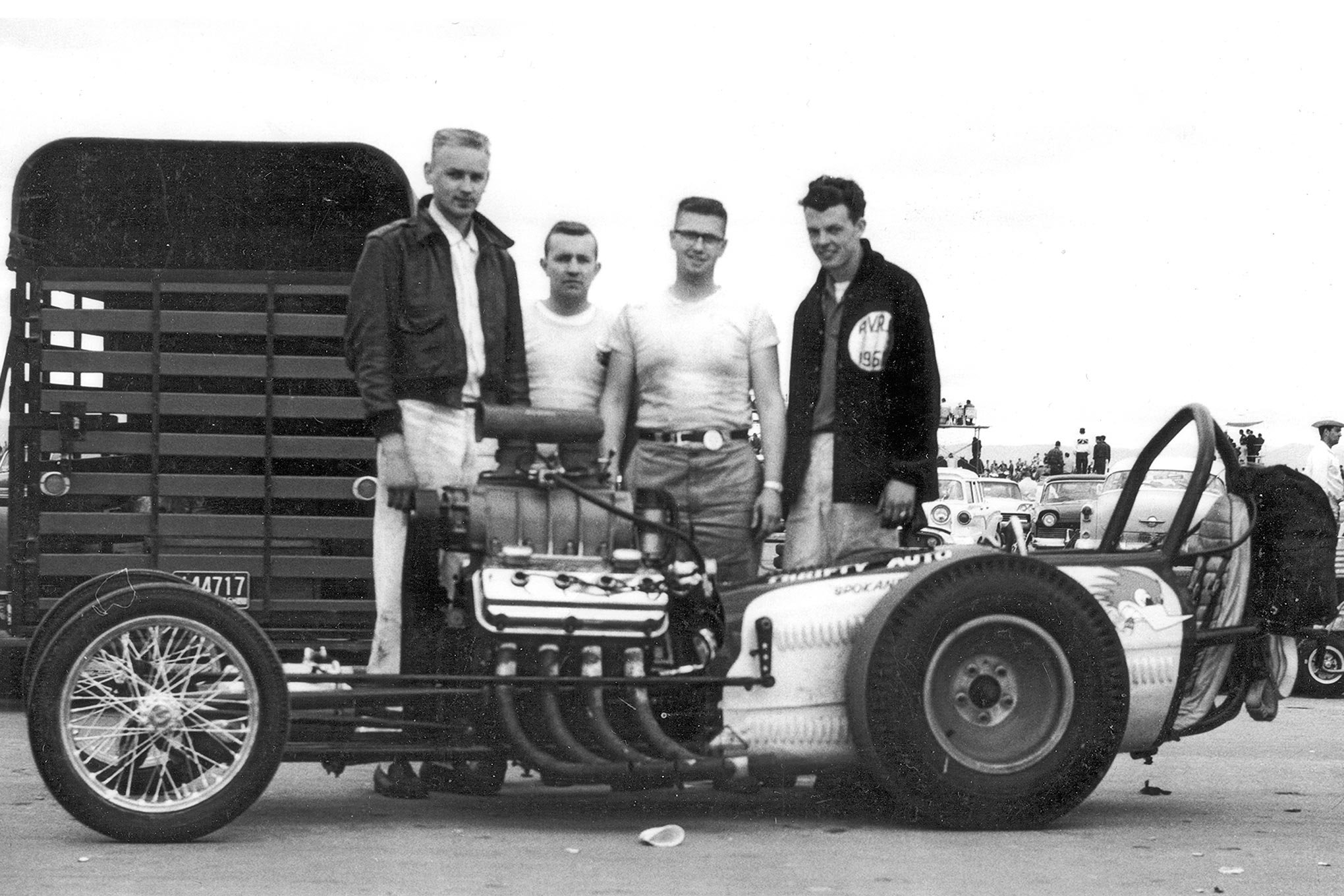 Some speculated that the success of the Thrifty Automotive dragster was due to the car's uncommonly short wheelbase. Though unintentional, it served the ultimate foil for a hidden port-injected nitrous system. From left to right are driver Don Stortroen, crewmember Laurie Moreau, engine builder Dick Flynn, and crewmember Lew Shaw at the fabled 1961 March Meet.