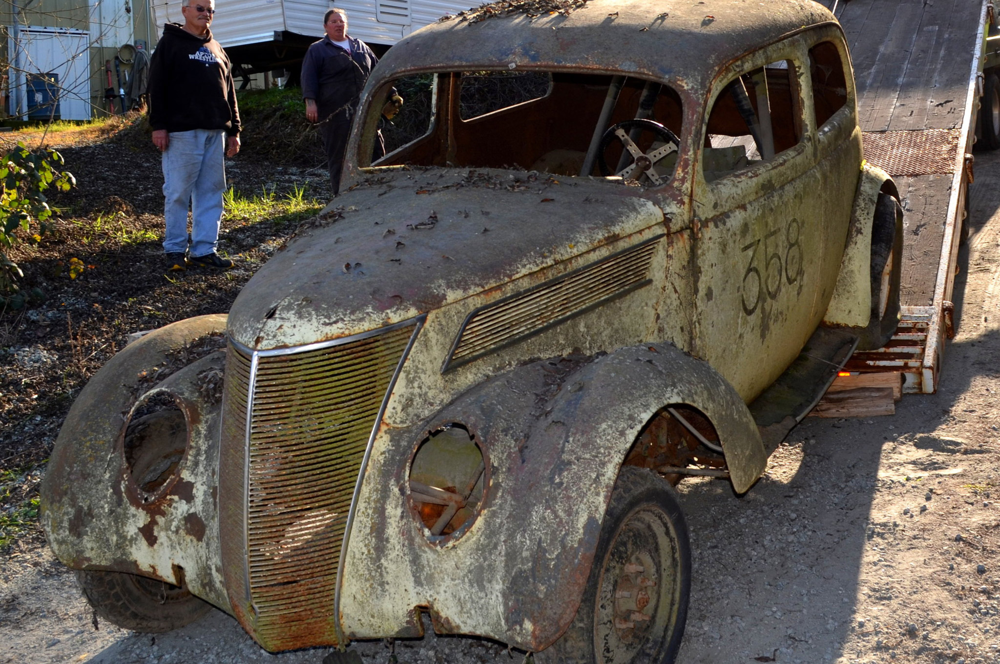 Aside from being covered in moss, the car had very little body damage when it was pulled from its 50-year hibernation. There were some bad rust spots in the lower areas of the car, but otherwise it was relatively rust-free, amazing considering it was in storage in damp air close to the ocean for years.  (photo: Joe Hickenbottom)